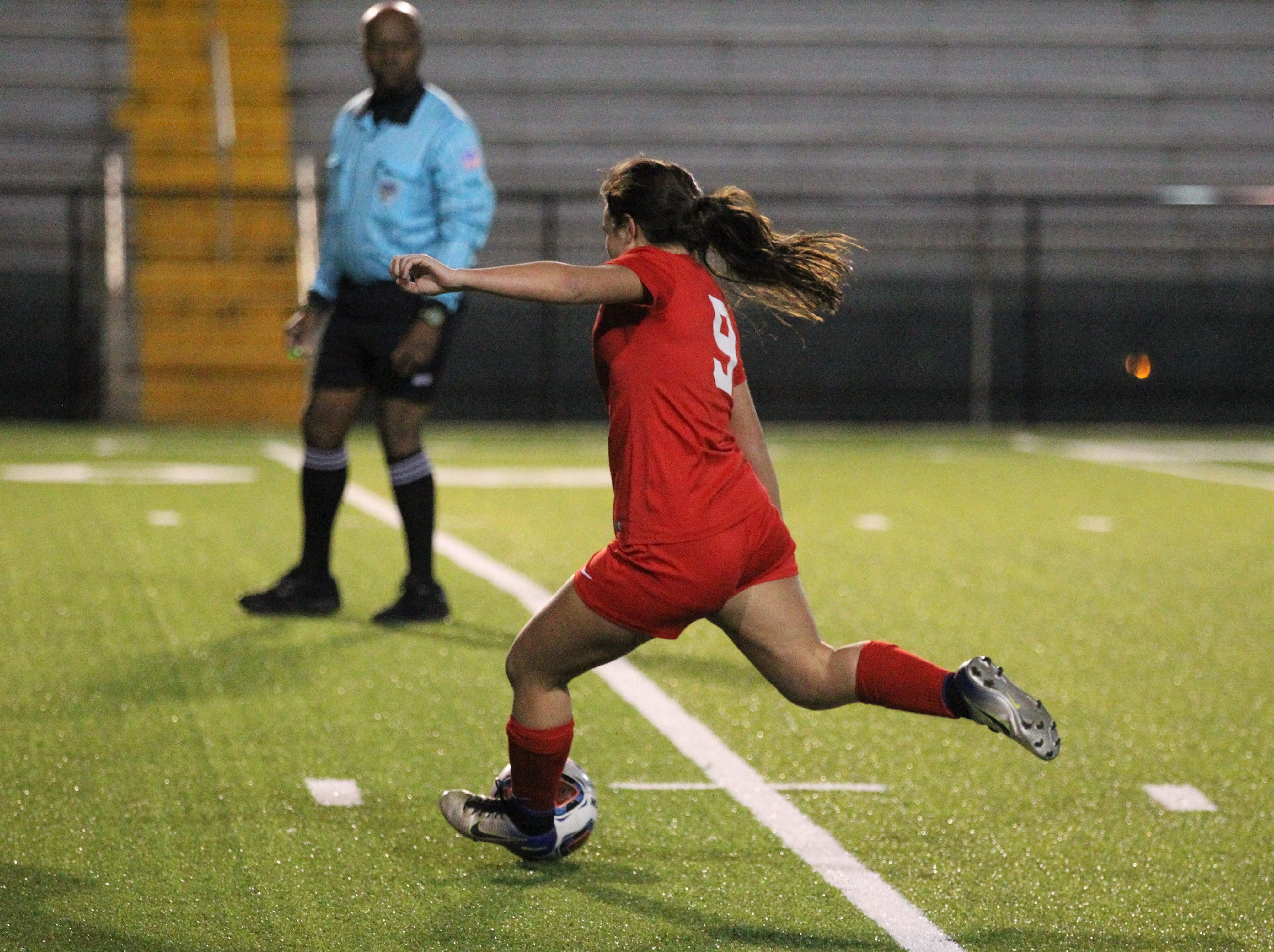 Leon's Ashley Fink sends a pass back into her offensive third as Niceville's girls soccer team beat Leon 1-0 in a Region 1-4A semifinal at Gene Cox Stadium on Jan. 8, 2019.