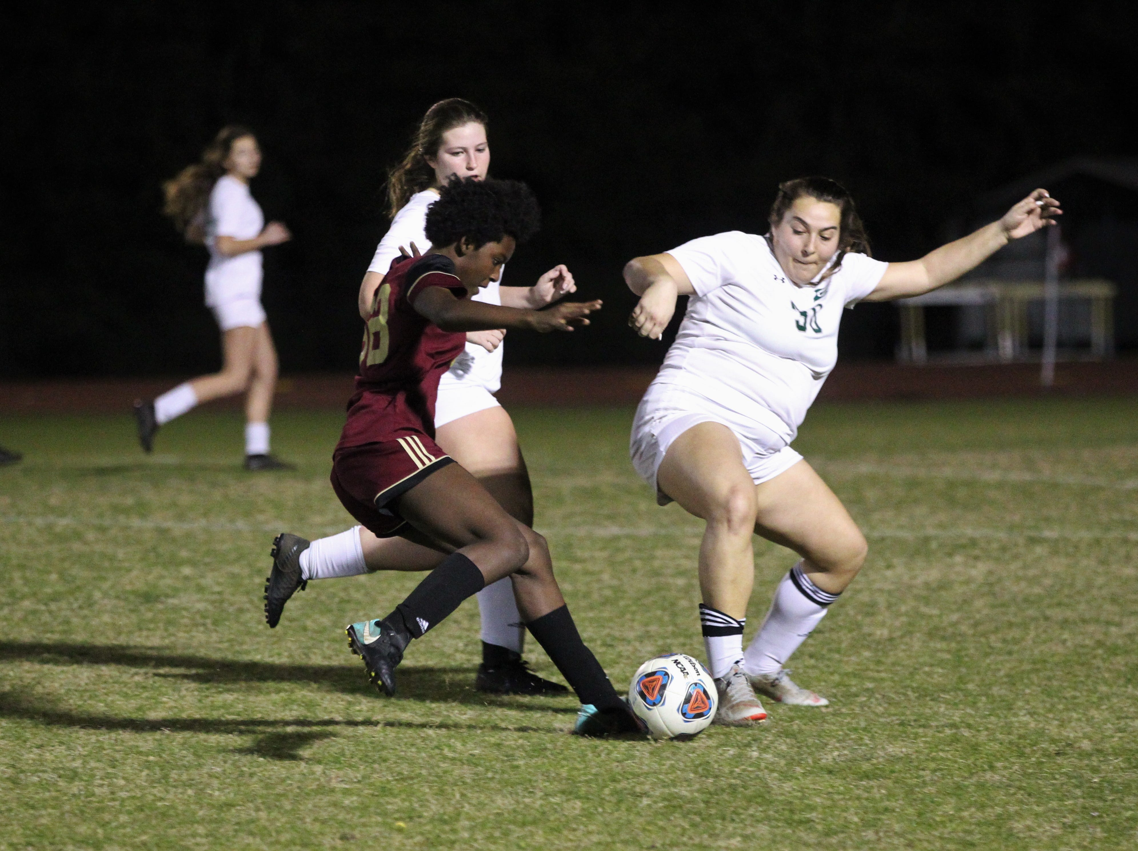 Florida High's Jordyn Still has her dribble disrupted as South Walton edged the Seminoles 5-4 in a penalty-kick shootout during a Region 1-2A semifinal on Feb. 8, 2019.