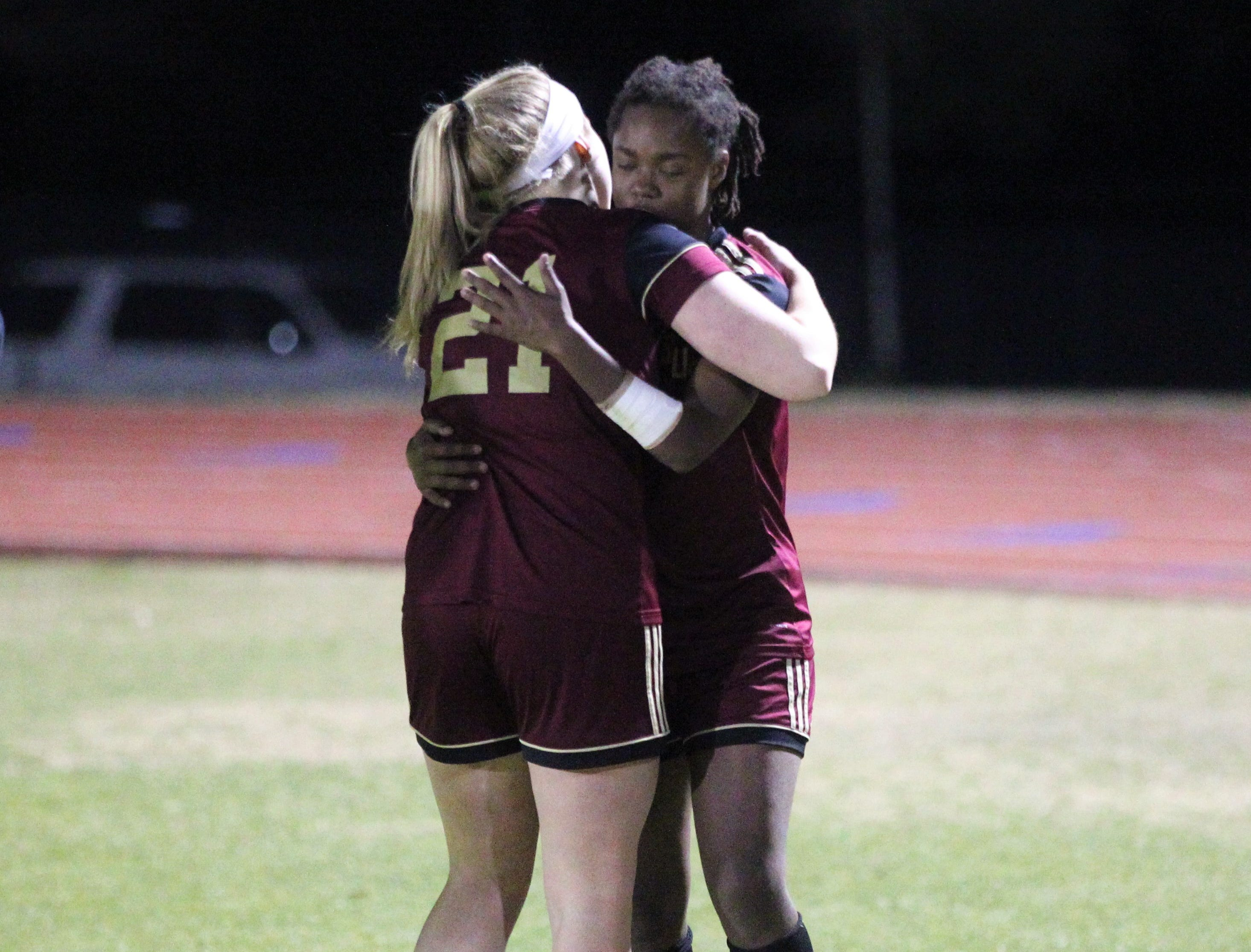 Florida High's Claire Wilder greets Janae Scott, who was injured and missed 40 minutes of soccer, as South Walton's girls soccer team edged the Seminoles 5-4 in a penalty-kick shootout during a Region 1-2A semifinal on Feb. 8, 2019.