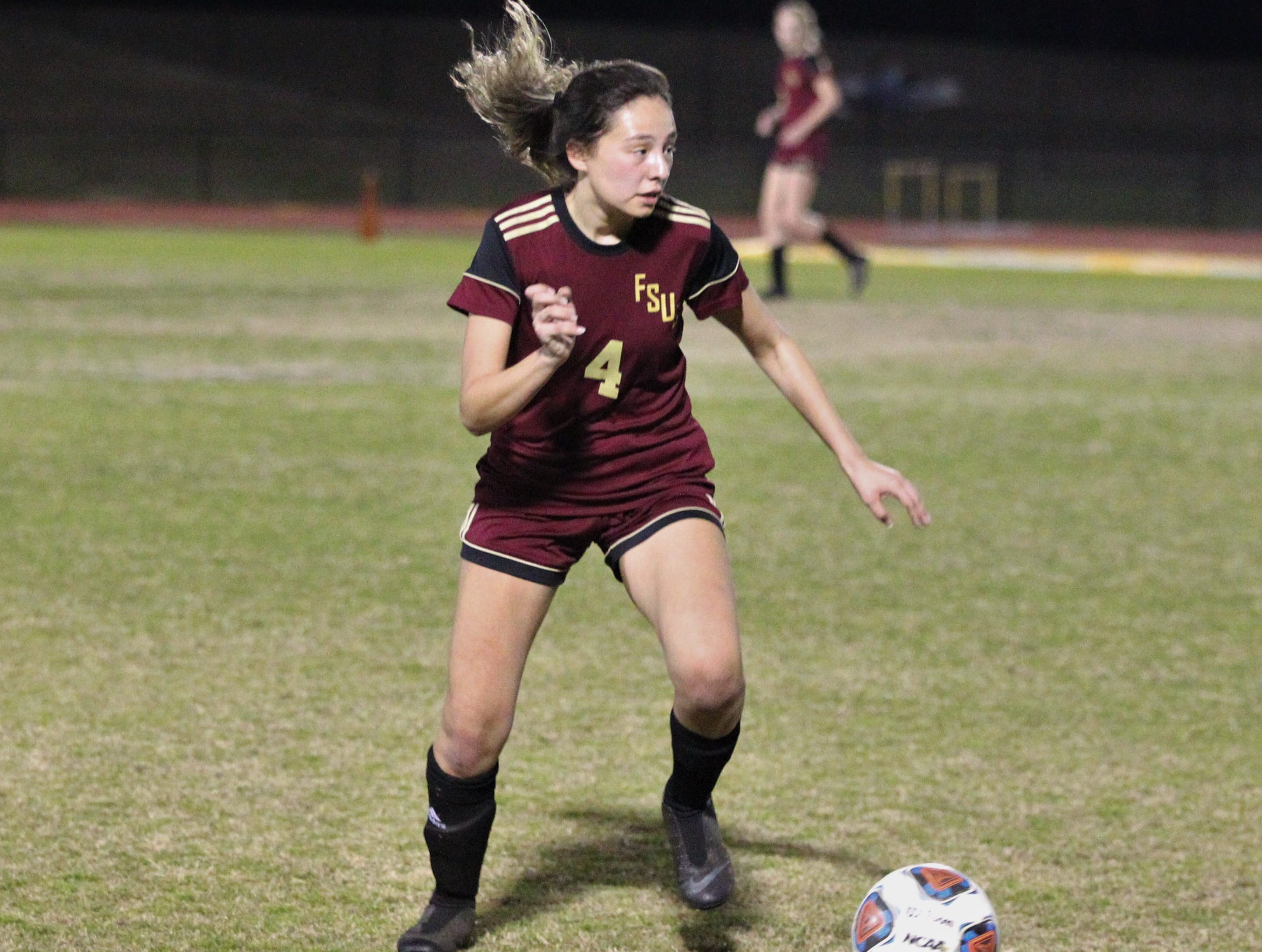 Florida High's Daphne Cervantes looks upfield for a pass as South Walton edged the Seminoles 5-4 in a penalty-kick shootout during a Region 1-2A semifinal on Feb. 8, 2019.