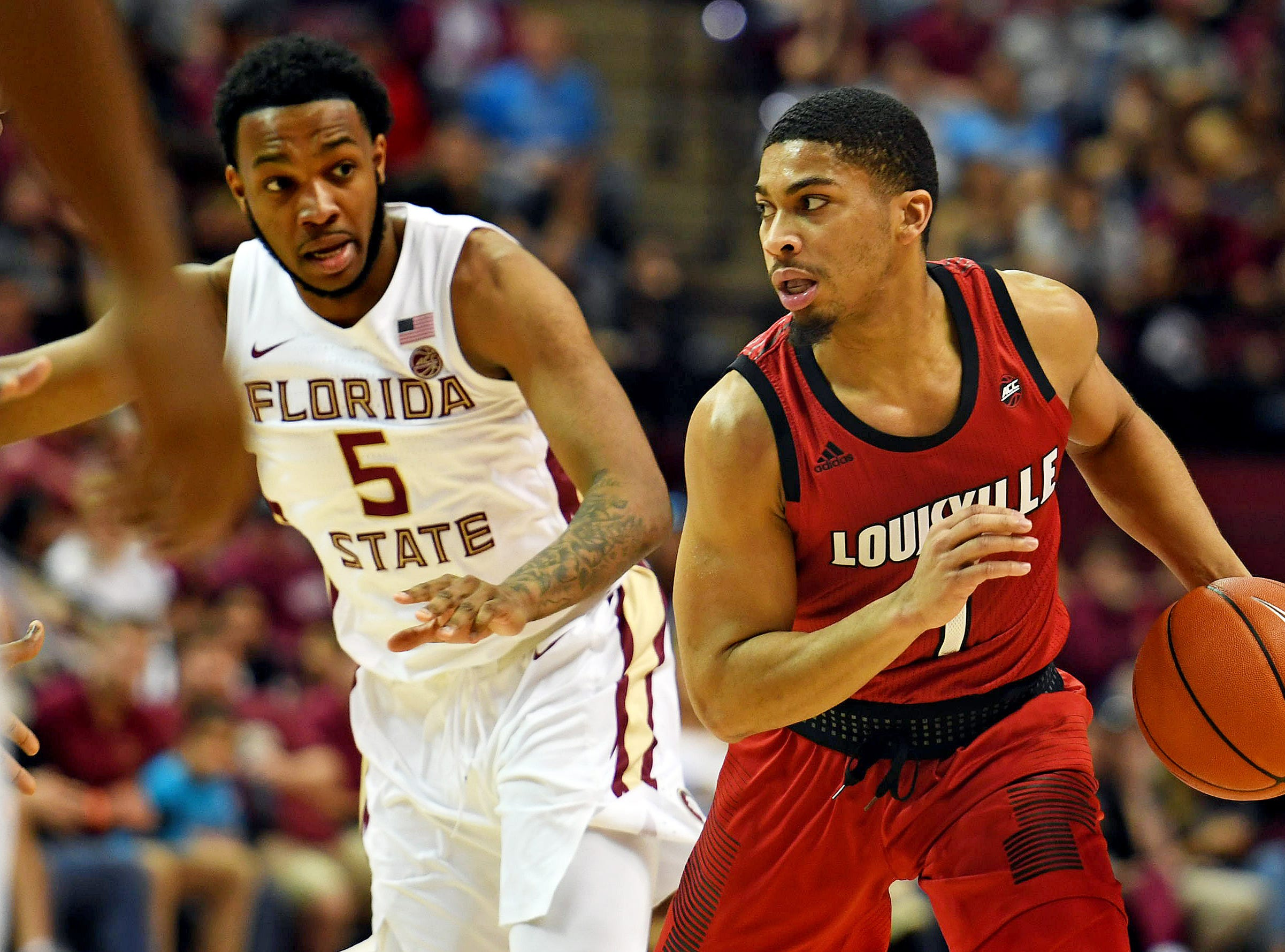 Feb 9, 2019; Tallahassee, FL, USA; Louisville Cardinals guard Christen Cunningham (1) drives the ball against Florida State Seminoles guard PJ Savoy (5) during the first half at Donald L. Tucker Center. Mandatory Credit: Melina Myers-USA TODAY Sports