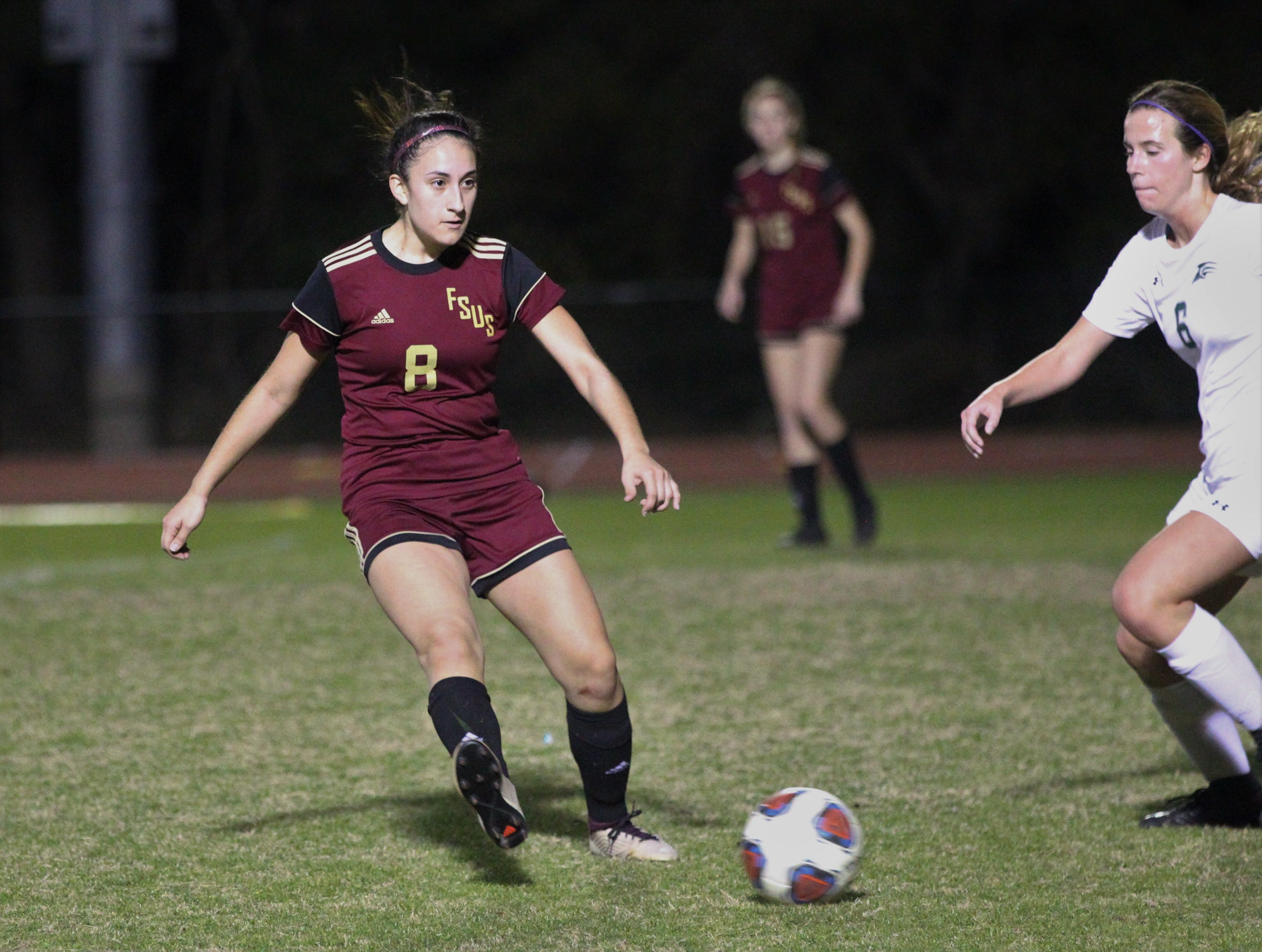 Florida High's Lily Quijada passes ahead as South Walton edged the Seminoles 5-4 in a penalty-kick shootout during a Region 1-2A semifinal on Feb. 8, 2019.