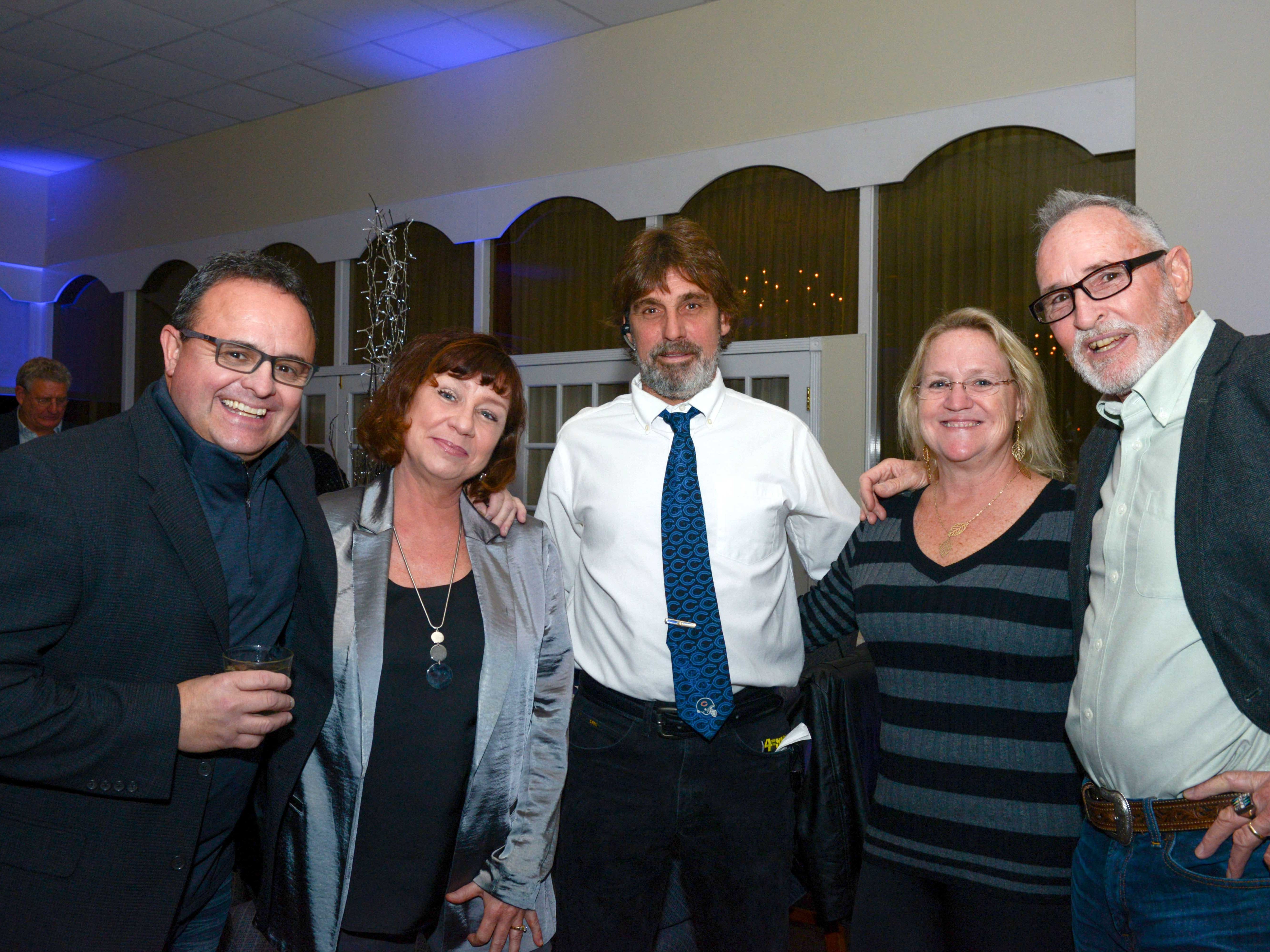 Dominick and Kate Alvira, Kurt and Cindy Blomquist and Timothy Cartwright at Family Meals' Black Tie, Blue Jeans & Bingo fundraiser in Fort Pierce.