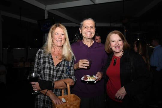 "Stephanie Morgan, left, Leo Ladifian and Jane Ladifian at Port St. Lucie Sunset Rotary Club's ""Beast and Bourbon Dinner"" on Jan. 24."