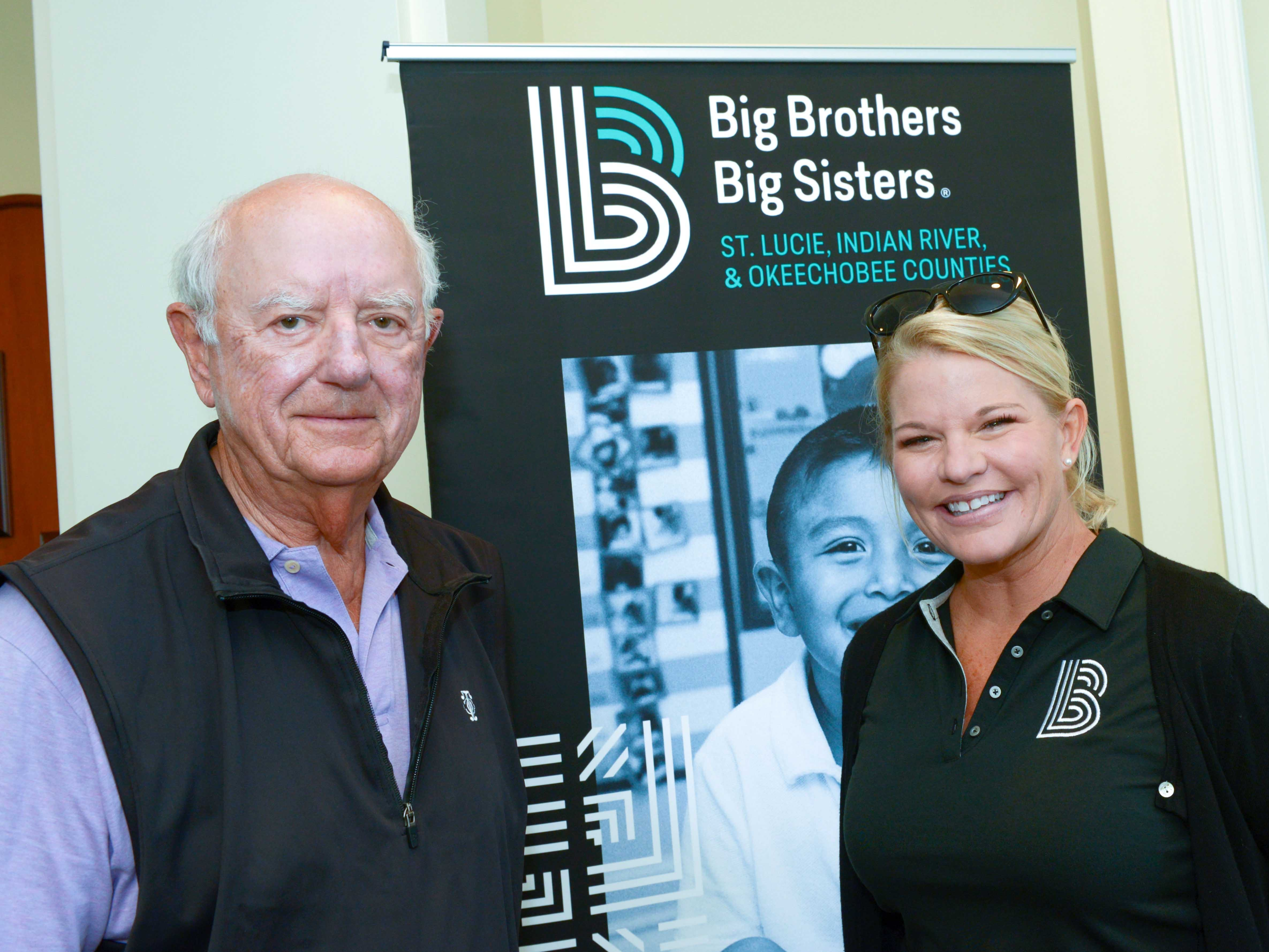 Golf Cart Sponsor Dale Sorensen of Dale Sorensen Real Estate with Big Brothers Big Sisters CEO Stacey Watson-Mesley at Hawk's Nest Golf Club for the golf tournament on Feb. 4.