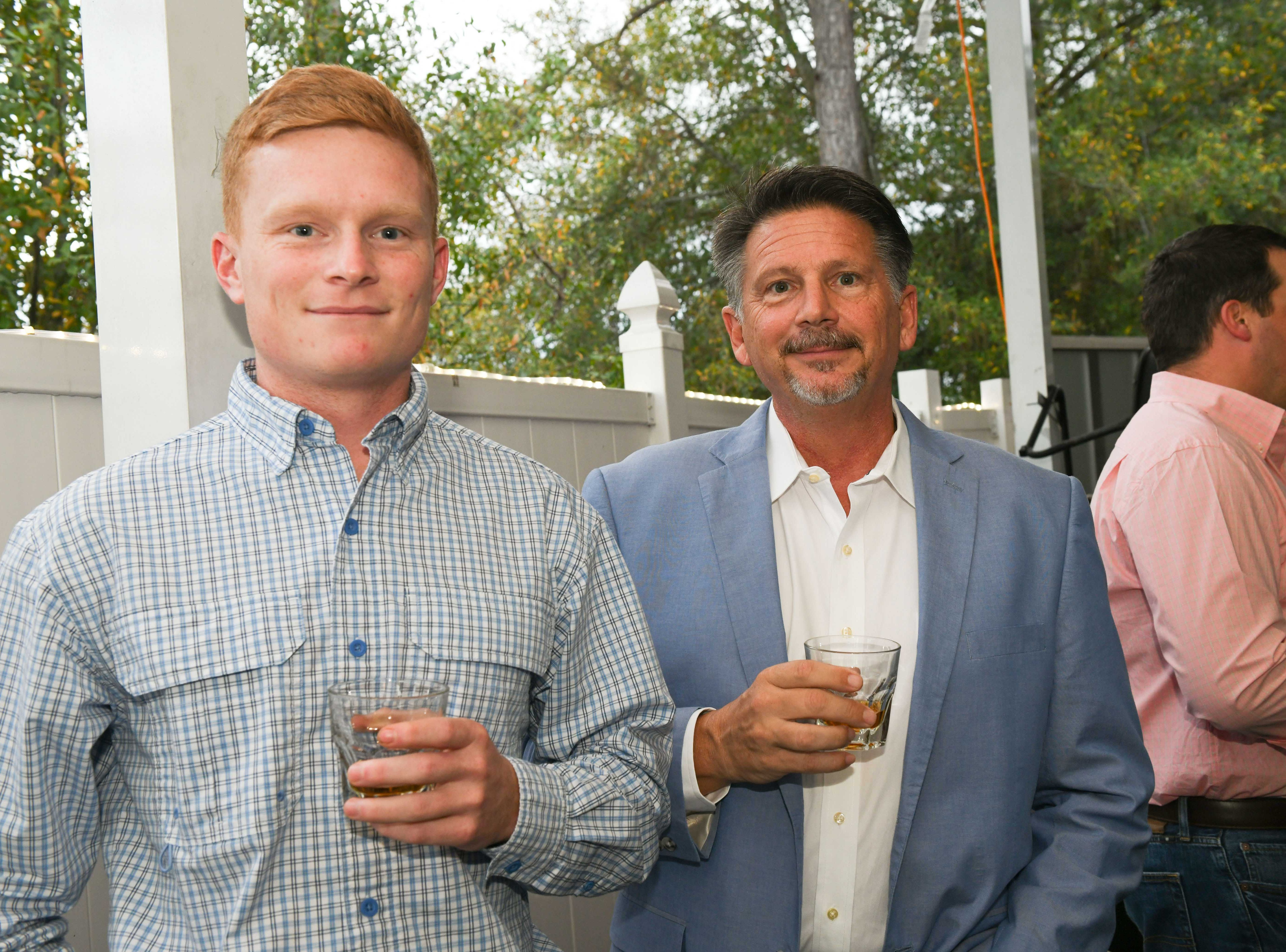 "Austin Lane, left, and Kevin Trost at Port St. Lucie Sunset Rotary Club's ""Beast and Bourbon Dinner"" on Jan. 24."