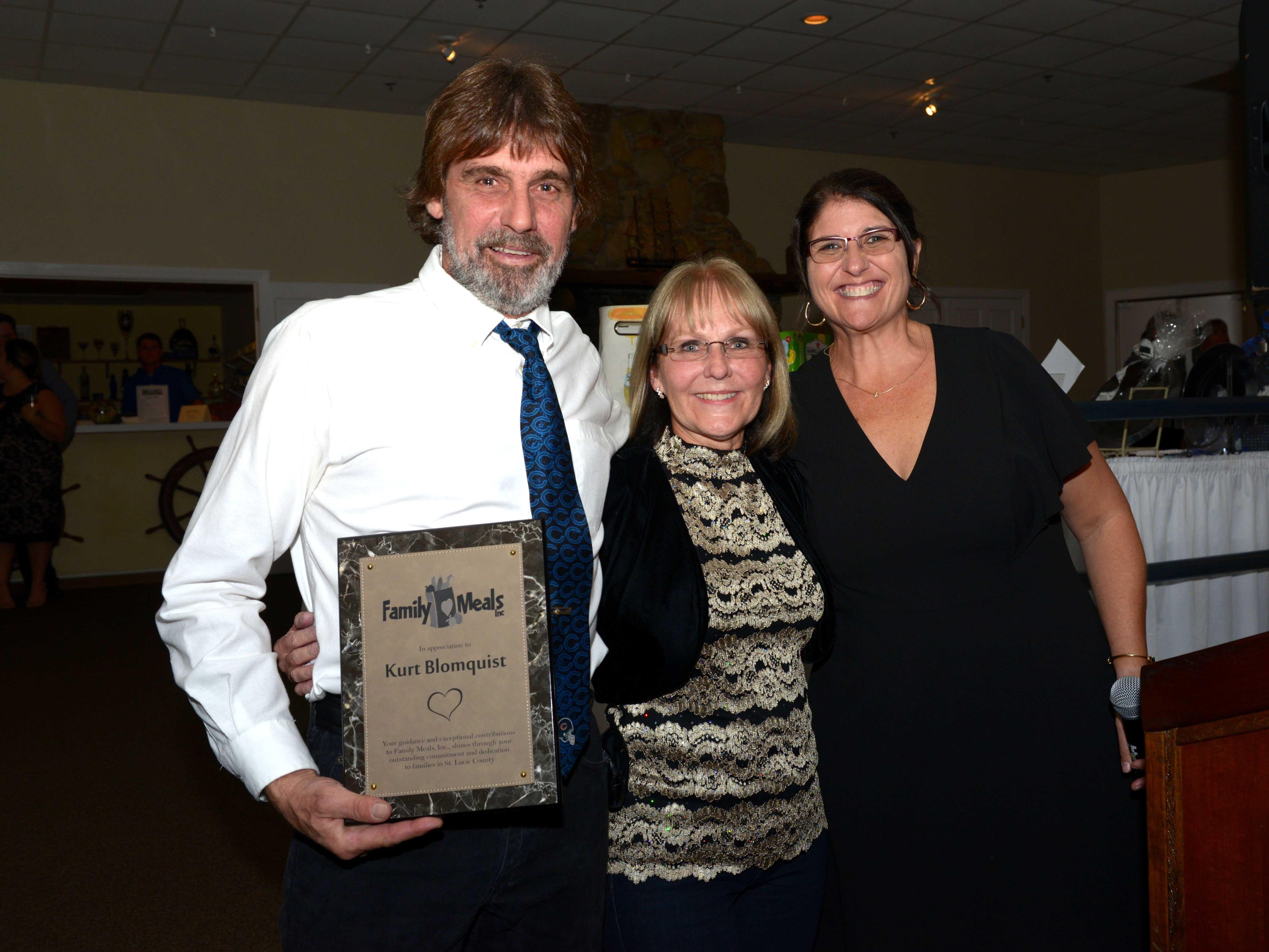 Volunteer Kurt Blomquist, left, Debbie Reed and Kerri Jakubczak at Family Meals' Black Tie, Blue Jeans & Bingo fundraiser in Fort Pierce.