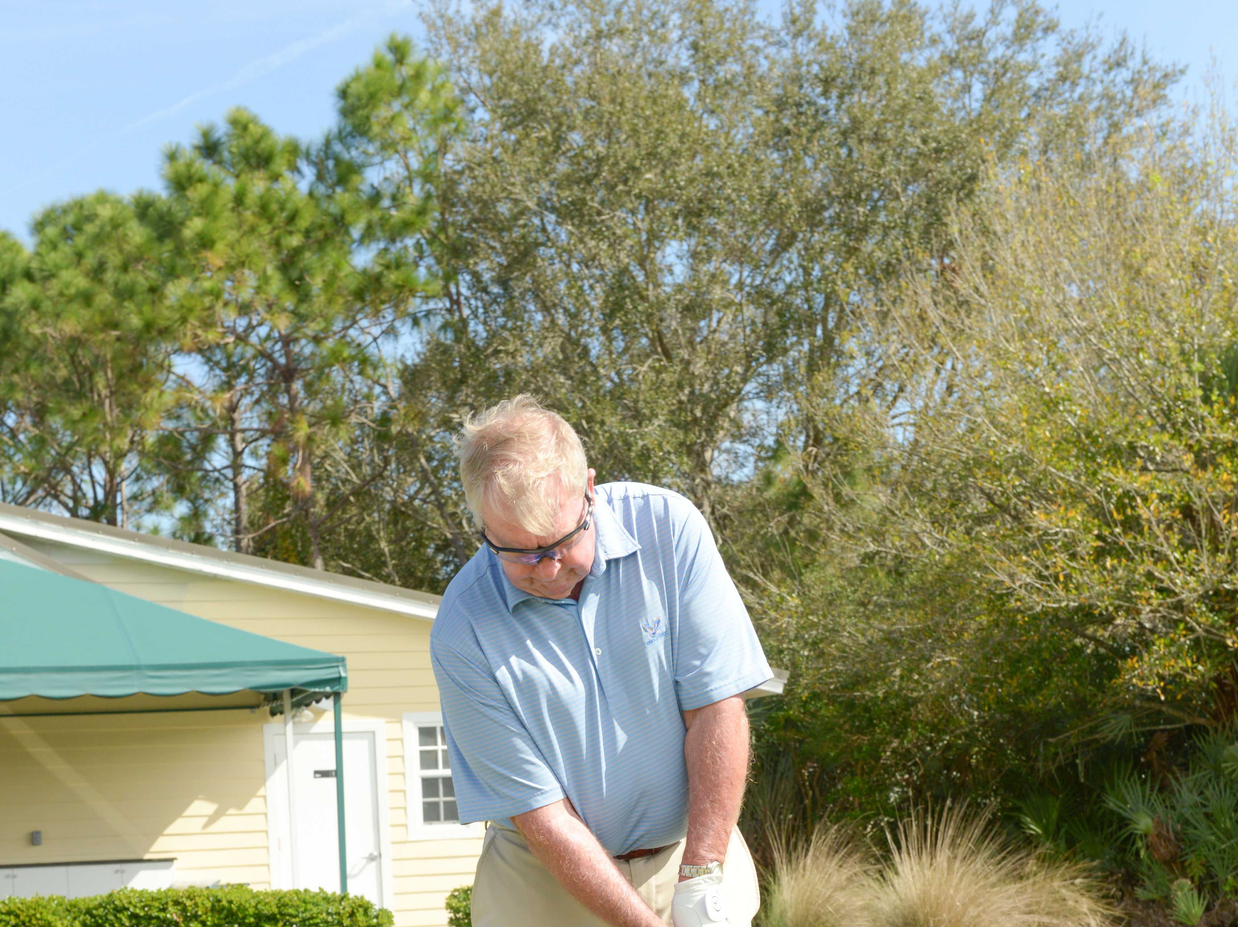 Martin Alger hits a chip shot at Hawk's Nest Golf Club for the Big Brothers Big Sisters Golf Tournament on Feb. 4.
