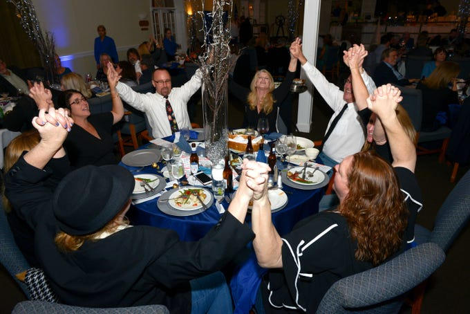 Singing along at Family Meals' Black Tie, Blue Jeans & Bingo fundraiser in Fort Pierce.
