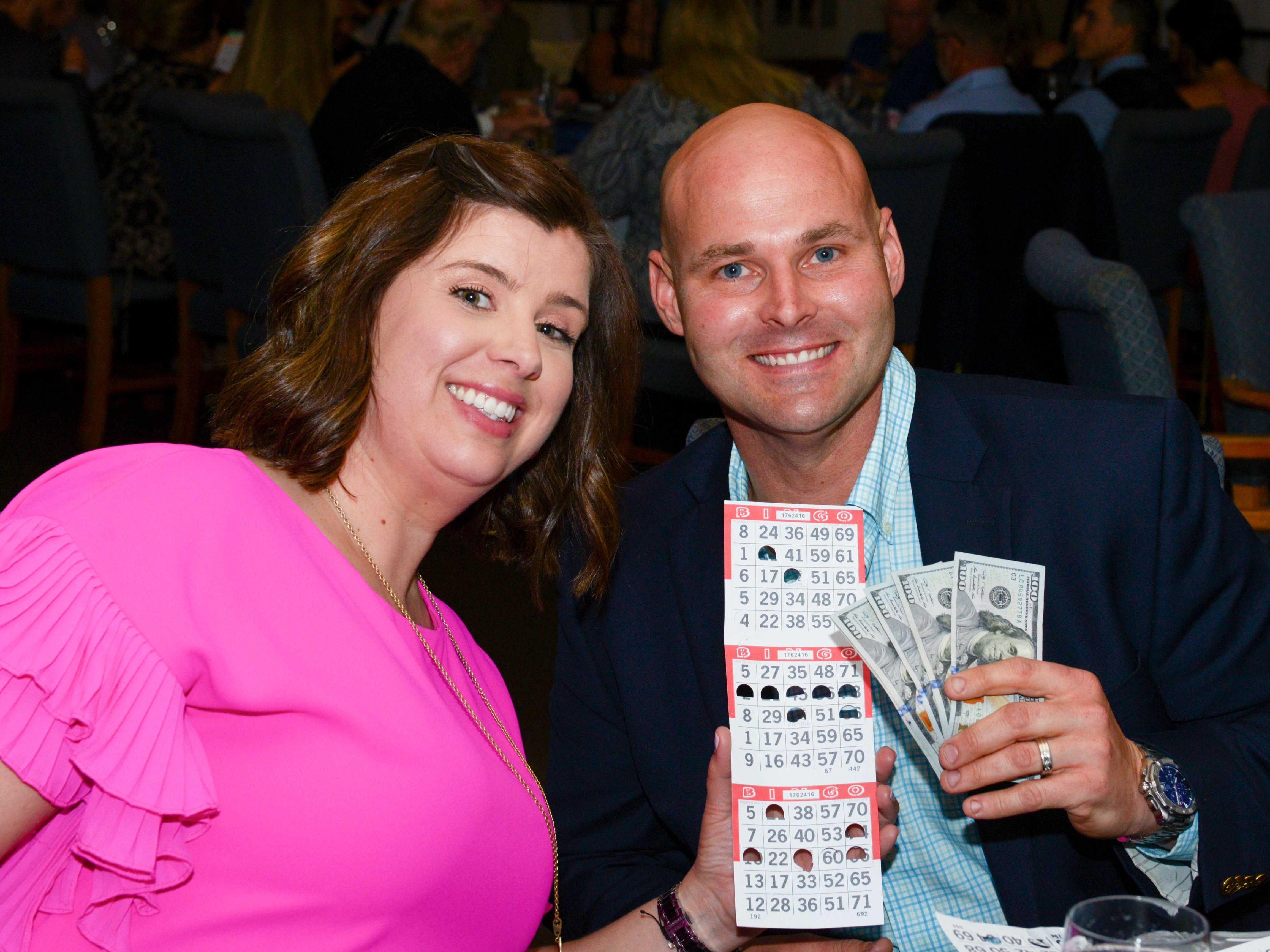 Quinn and Chris Wheeler, bingo winner, at Family Meals' Black Tie, Blue Jeans & Bingo fundraiser in Fort Pierce.