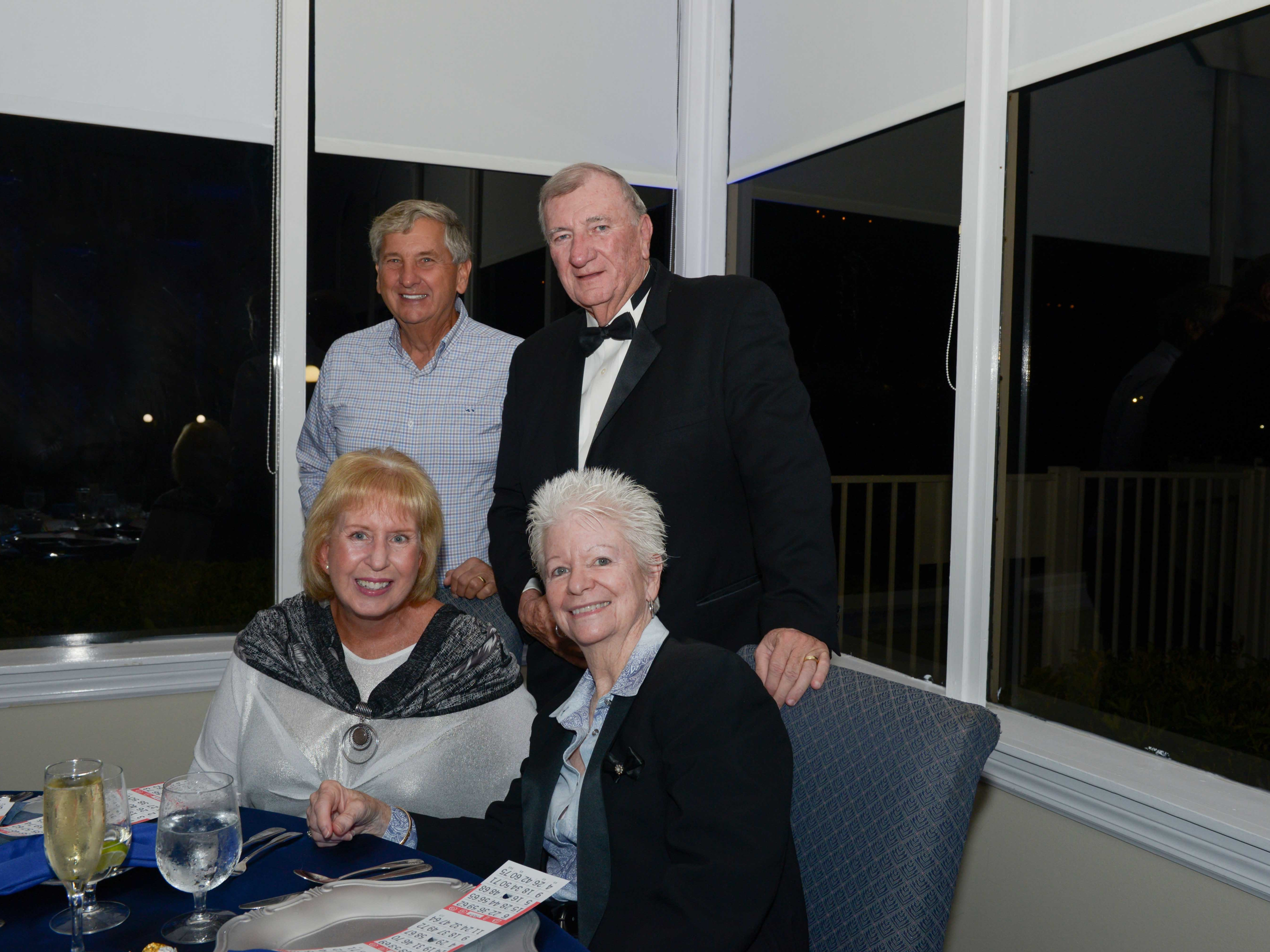Walter and Natalie Steen, left, and Hal and Susan Roberts at Family Meals' Black Tie, Blue Jeans & Bingo fundraiser in Fort Pierce.