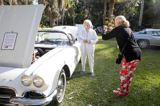 """One of our favorite things about owning the car is knowing the history of it,"" said Nancy Hamilton of Tampa (right), who takes a photo of Alma Lee Loy in front of Hamilton's original 1962 Corvette at McKee Botanical Garden's 10th annual Motor Car Exhibition on Saturday, Feb. 9, 2019, in Vero Beach. Nancy Hamilton and her husband, Fred (not pictured) are the third owners of the car. It was originally owned by Indian River County pioneer Ruth Hallstrom. Loy talked to the Hamiltons about her memories of the car. Forty Corvettes from the very first year, 1953, to present were on display at the event."