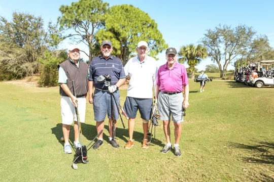 Mike Dacey, left, Al Howard, Len Odell and Paul DeSoye at Hawk's Nest Golf Club for the Big Brothers Big Sisters Golf Tournament on Feb. 4.