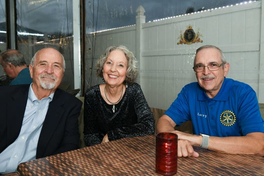 """Jim Harris, left, Linda Harris and Larry Breault at Port St. Lucie Sunset Rotary Club's """"Beast and Bourbon Dinner"""" on Jan.24."""