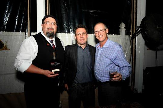 "Henry Infanti, left, Tim Dacko and Greg Weinbergat Port St. Lucie Sunset Rotary Club's ""Beast and Bourbon Dinner"" on Jan.24."
