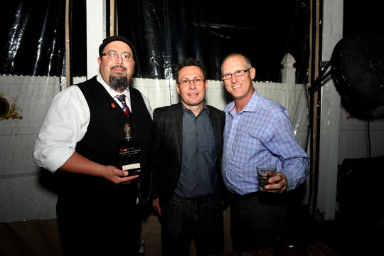"Henry Infanti, left, Tim Dacko and Greg Weinberg at Port St. Lucie Sunset Rotary Club's ""Beast and Bourbon Dinner"" on Jan. 24."