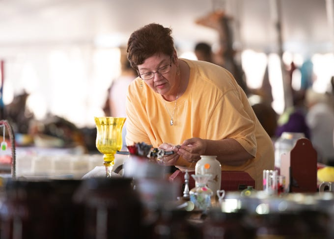 "Karen Billingsley, of Fort Pierce, looks through vintage jewelry at one of the retail booths at the 40th annual Greek Festival at St. Nicholas Greek Orthodox Church on Saturday, Feb. 9, 2019, in Fort Pierce. ""We enjoy the event so much, we came back,"" Billingsley said about attending the event for the second year in a row, adding, ""It's very nice."""