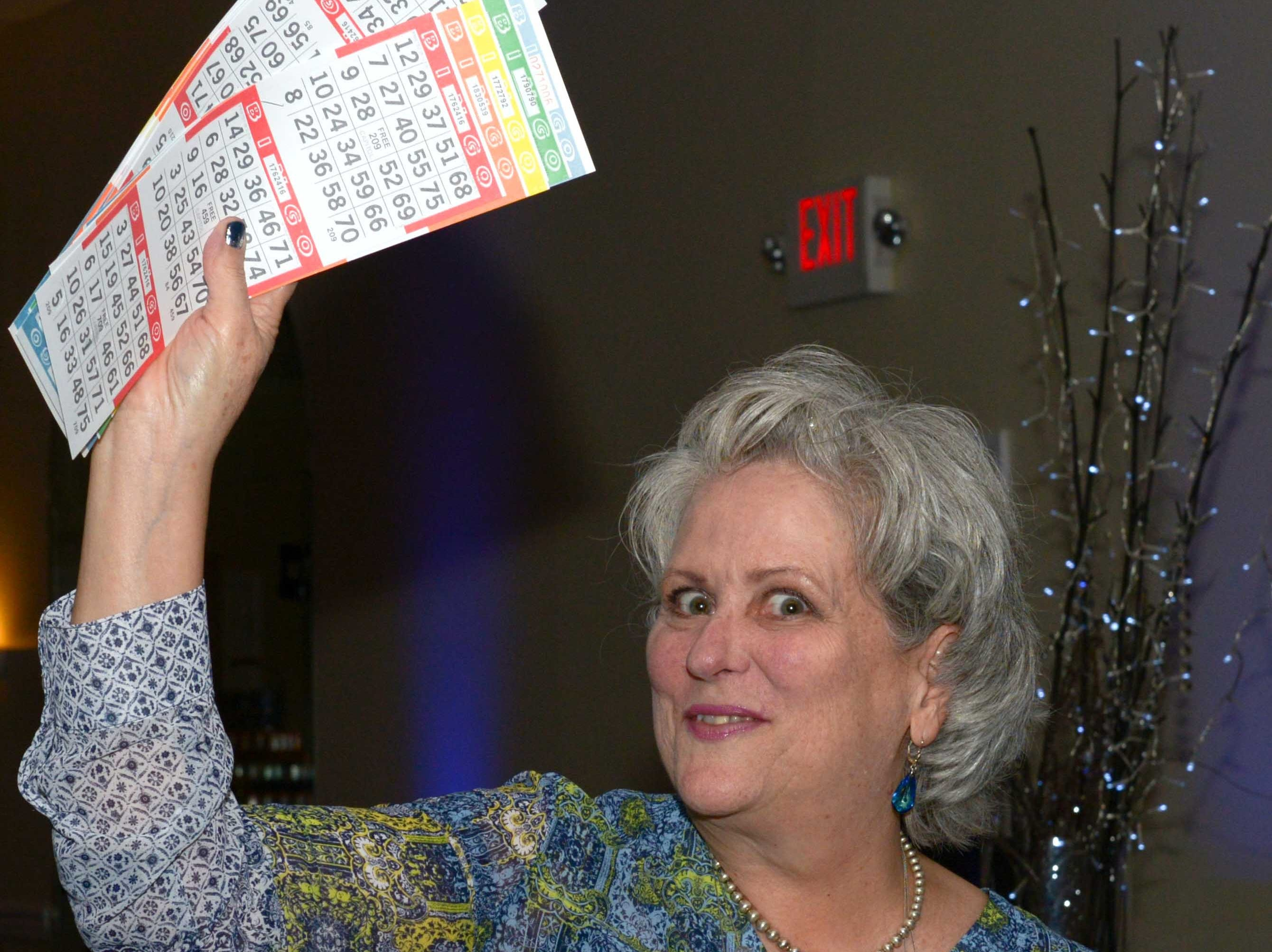 Dale VanderLugt, silent auction chair, at Family Meals' Black Tie, Blue Jeans & Bingo fundraiser in Fort Pierce.