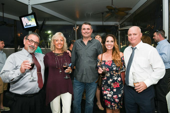 "Carl Torchia, left, Jackie Rios-Torchia, Jeff Banack, Jessica O'Connor and James ""Jet"" Thomson at Port St. Lucie Sunset Rotary Club's ""Beast and Bourbon Dinner"" on Jan. 24."
