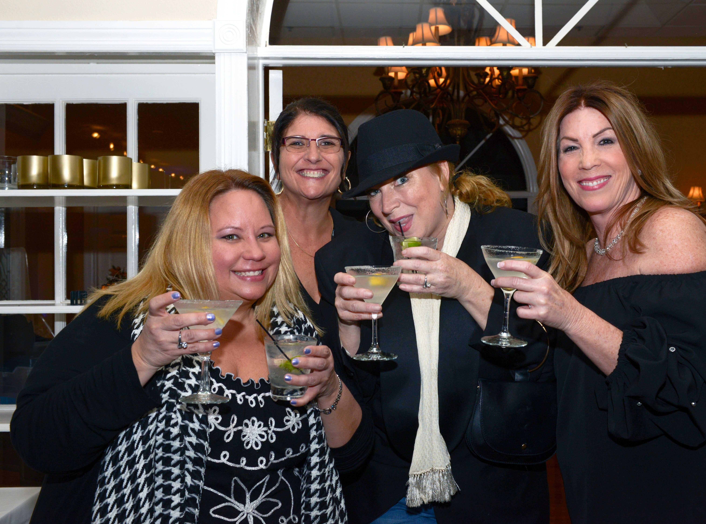 Barbara Guettler, left, Kerri Jakubczak, Kennifer Krip and birthday girl Susan Addison at Family Meals' Black Tie, Blue Jeans & Bingo fundraiser in Fort Pierce.