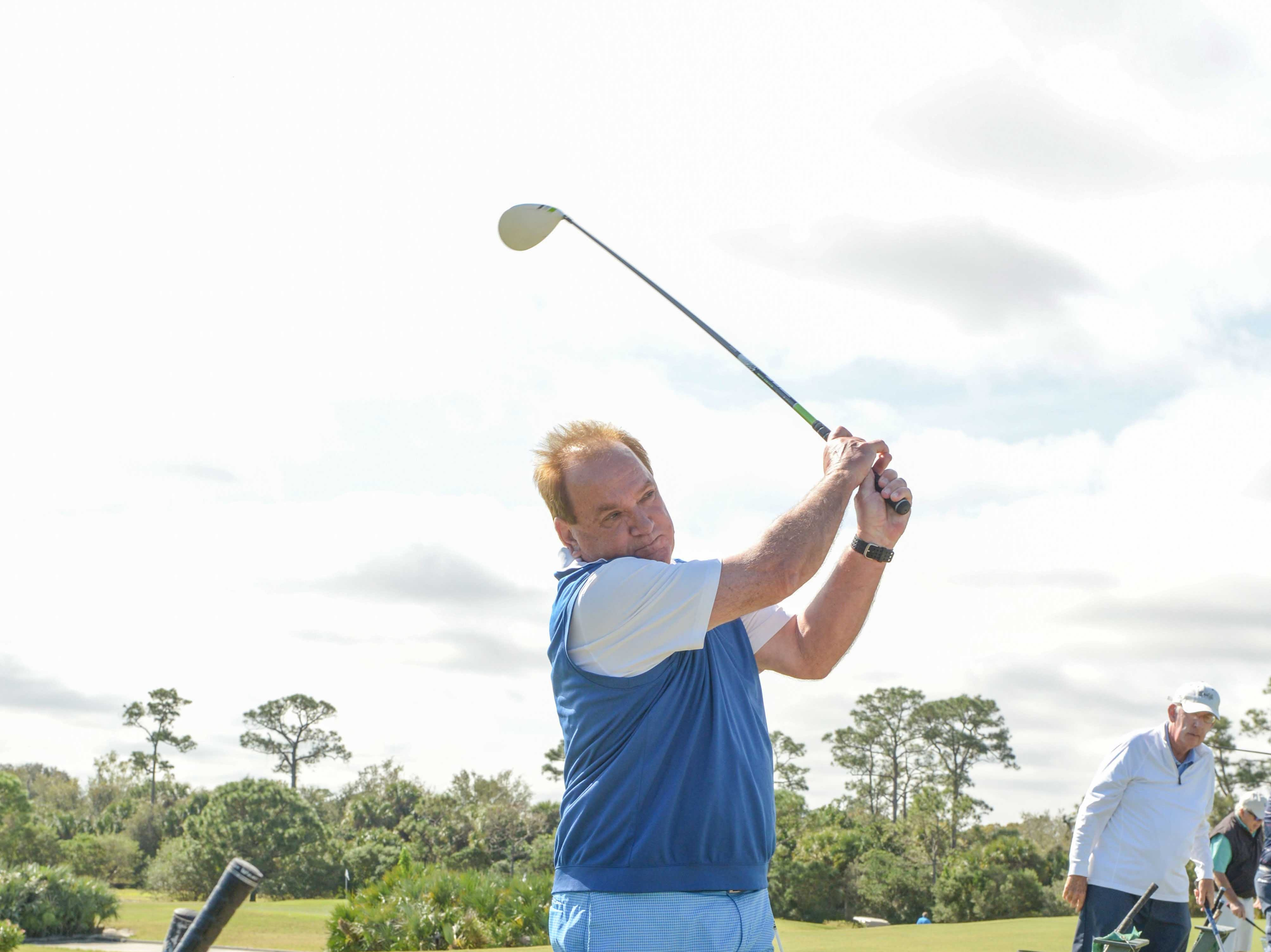 Dennis Witherow hits a few practice shots at Hawk's Nest Golf Club for the Big Brothers Big Sisters Golf Tournament on Feb. 4.