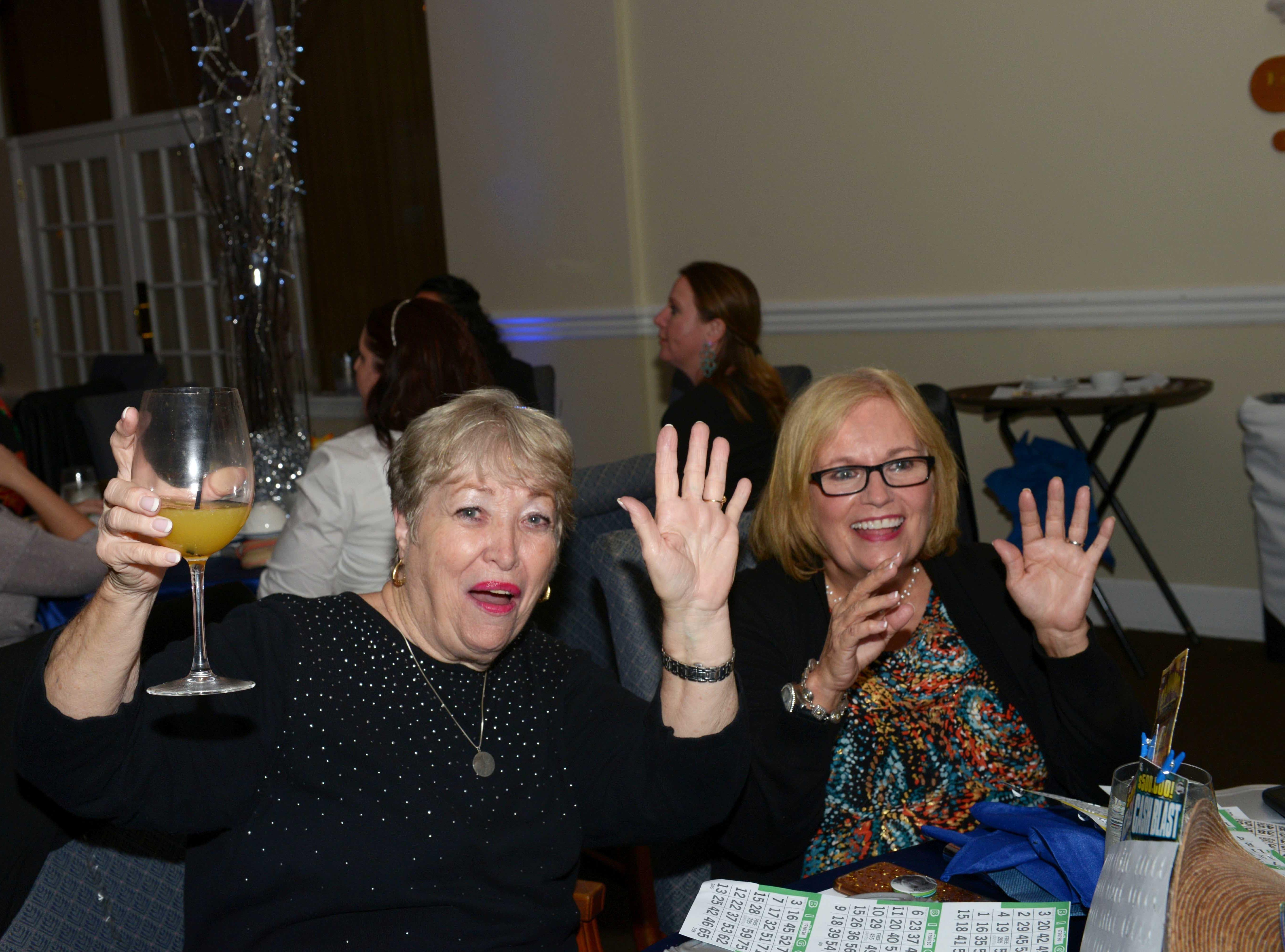 Tena Sigmon, left, and Sheila Votino at Family Meals' Black Tie, Blue Jeans & Bingo fundraiser in Fort Pierce.