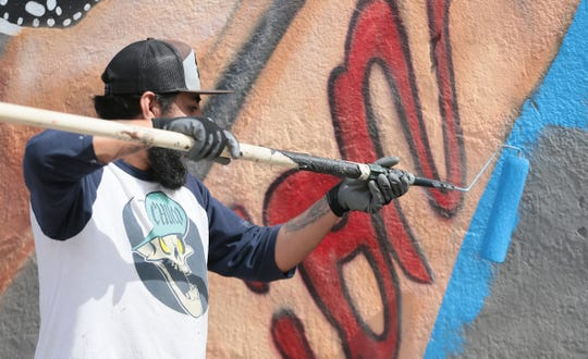 El Paso muralist Cimi Alvarado, who has worked on several murals in the city, will lead a tour on Valentine's Day.