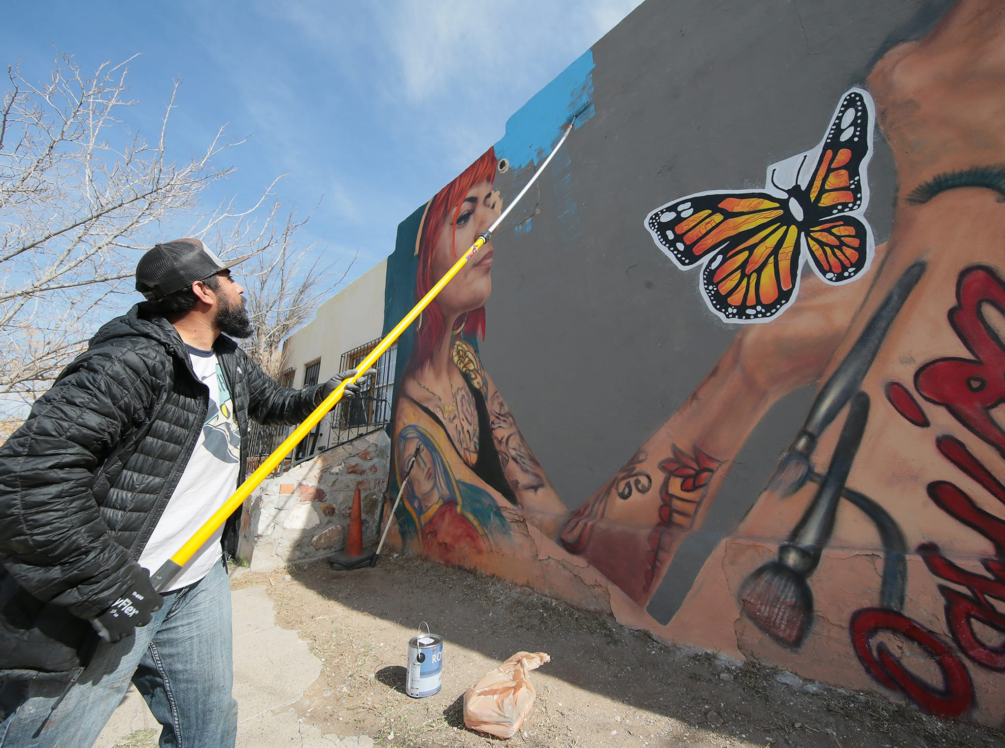 "El Paso muralist Cimi Alvarado is working to finish his latest mural at the corner of Tays and Delta in the Segundo Barrio. The mural follows closely a poem by Pavel Freidman, a child who was murdered at the Theresienstadt Concentration Camp. Alvarado said we can't repeat this history, citing the child migrant detention centers where refugees were being held.  The mural is a collaboration between Cimi Alvarado, The University of St. Thomas' VISION Program, Kalavera Culture Shop, Gloria Yrrobali and Martin ""Blast"" Zubia."
