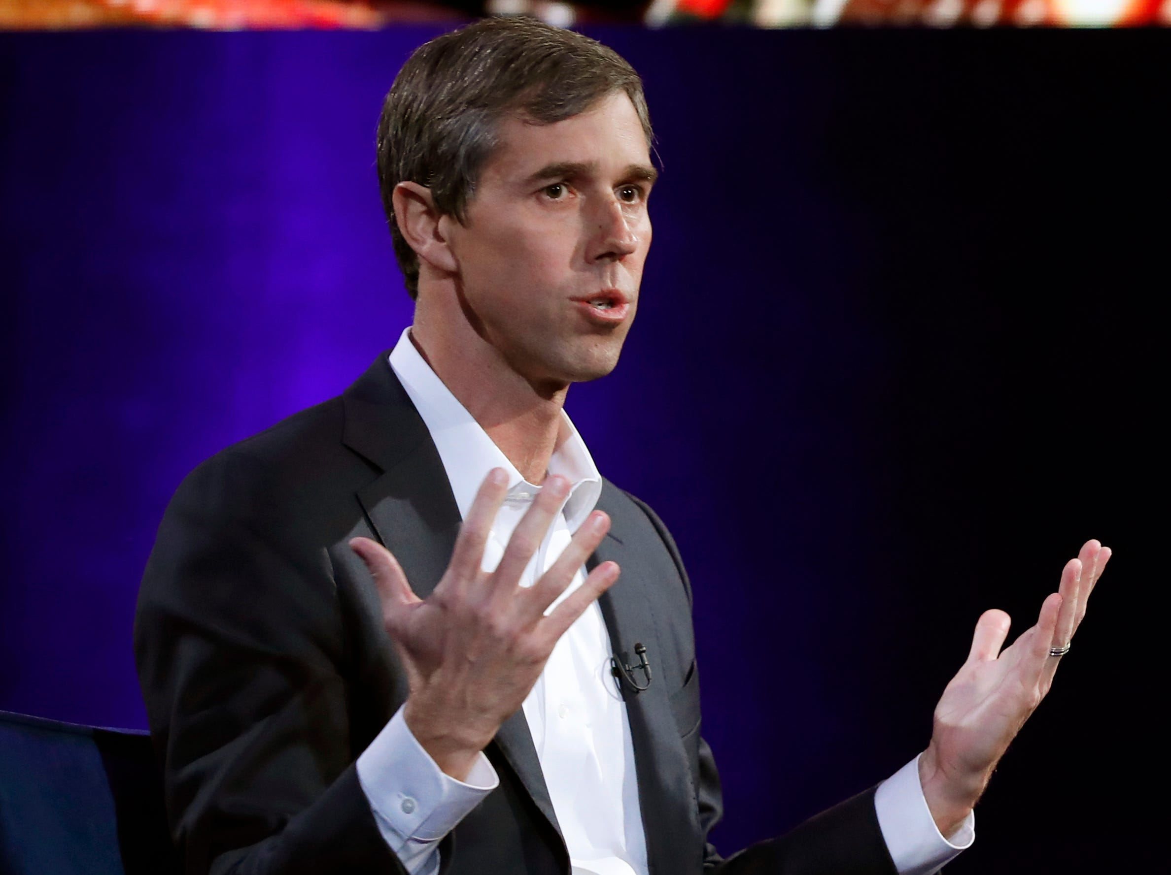 "Former U.S. Rep. Beto O'Rourke, D-El Paso, gestures during an interview with Oprah Winfrey live on a Times Square stage at ""SuperSoul Conversations"" on Tuesday, Feb. 5, 2019, in New York."