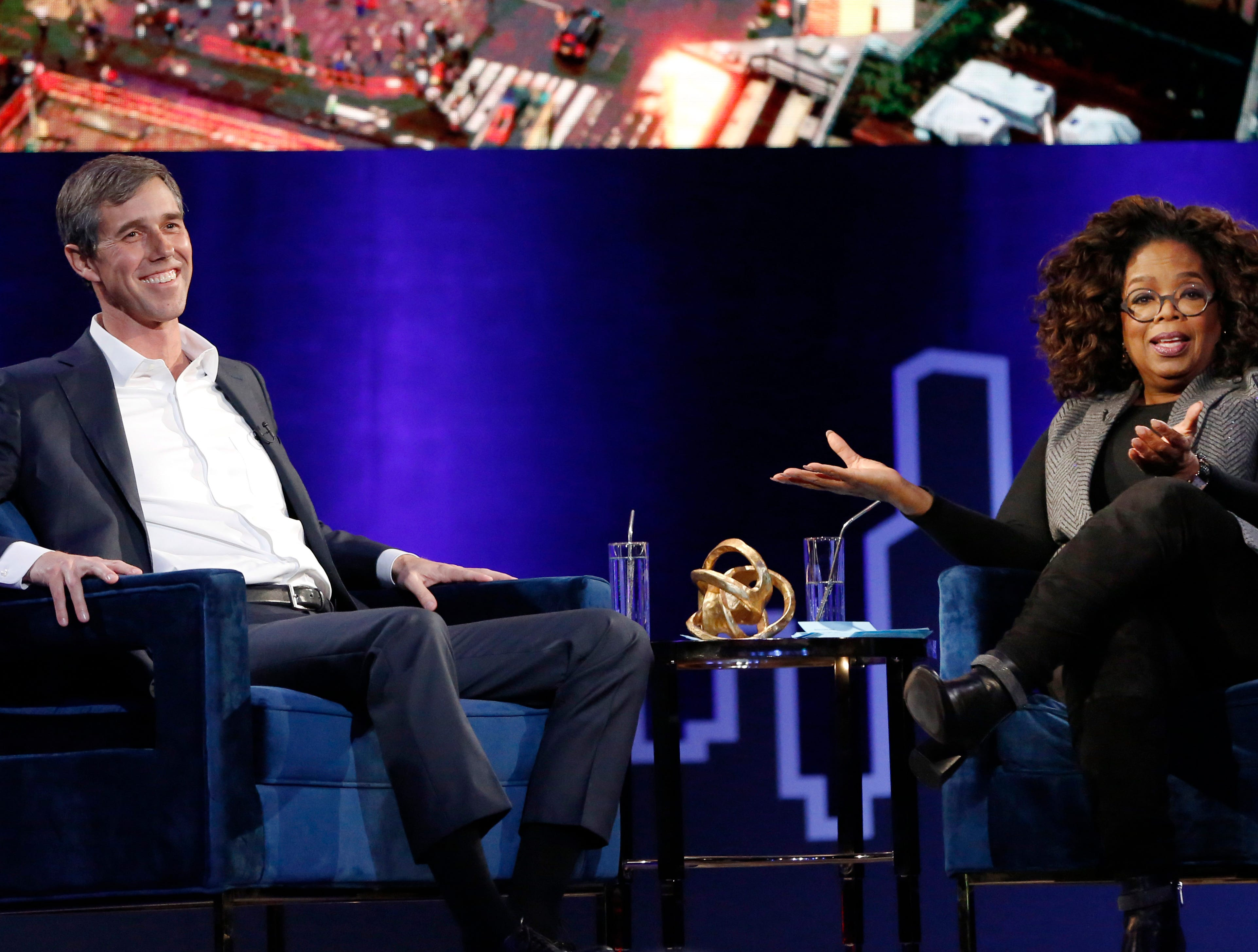 "Former U.S. Rep. Beto O'Rourke, D-El Paso, laughs during a live interview with Oprah Winfrey on a Times Square stage at ""Oprah's SuperSoul Conversations from Times Square"" on Tuesday, Feb. 5, 2019, in New York. O'Rourke dazzled Democrats last year by nearly defeating Republican U.S. Sen. Ted Cruz in the country's largest red state. O'Rourke says he'll announce whether he'll run for president ""before the end of the month."""
