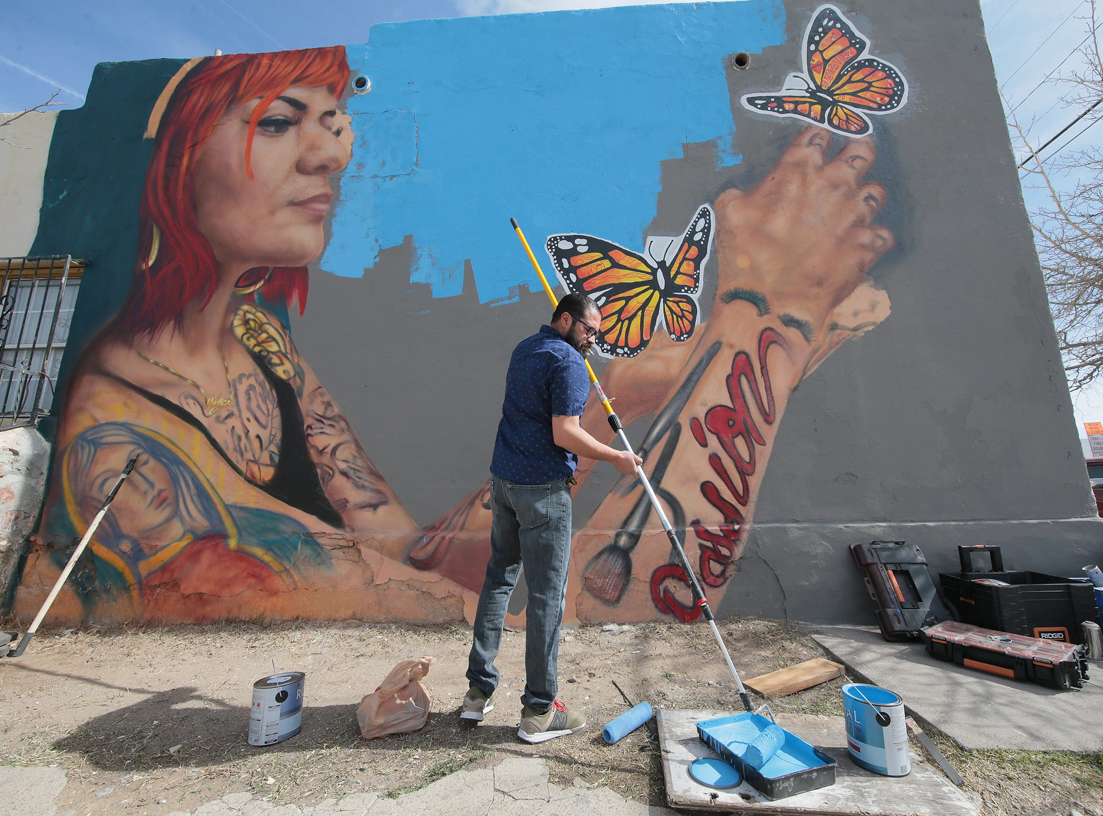 The mural at the corner of Tays Street and Delta Drive features an image of Gloria Yrrobali, owner of Bomb Beauty Products in El Paso, a news release said. Her image is posed in reference to the Virgen of Guadalupe and is purposely oriented toward Mexico.