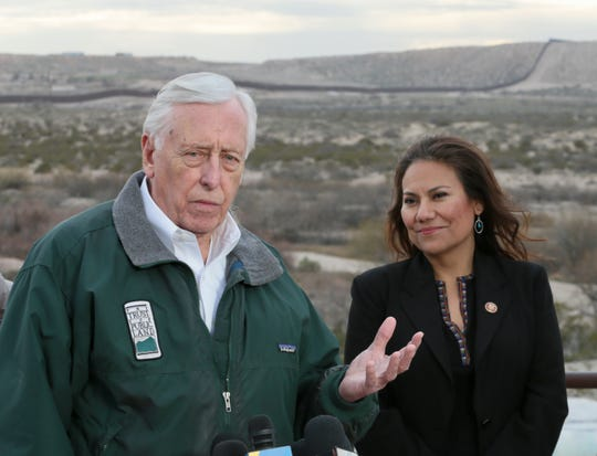House Majority Leader Steny Hoyer of Maryland and U.S. Rep. Veronica Escobar, D-El Paso, speak to the media Saturday after touring the border in the Sunland Park area, as well as the Paso Del Norte port of Entry and other areas. The border wall is shown behind them.