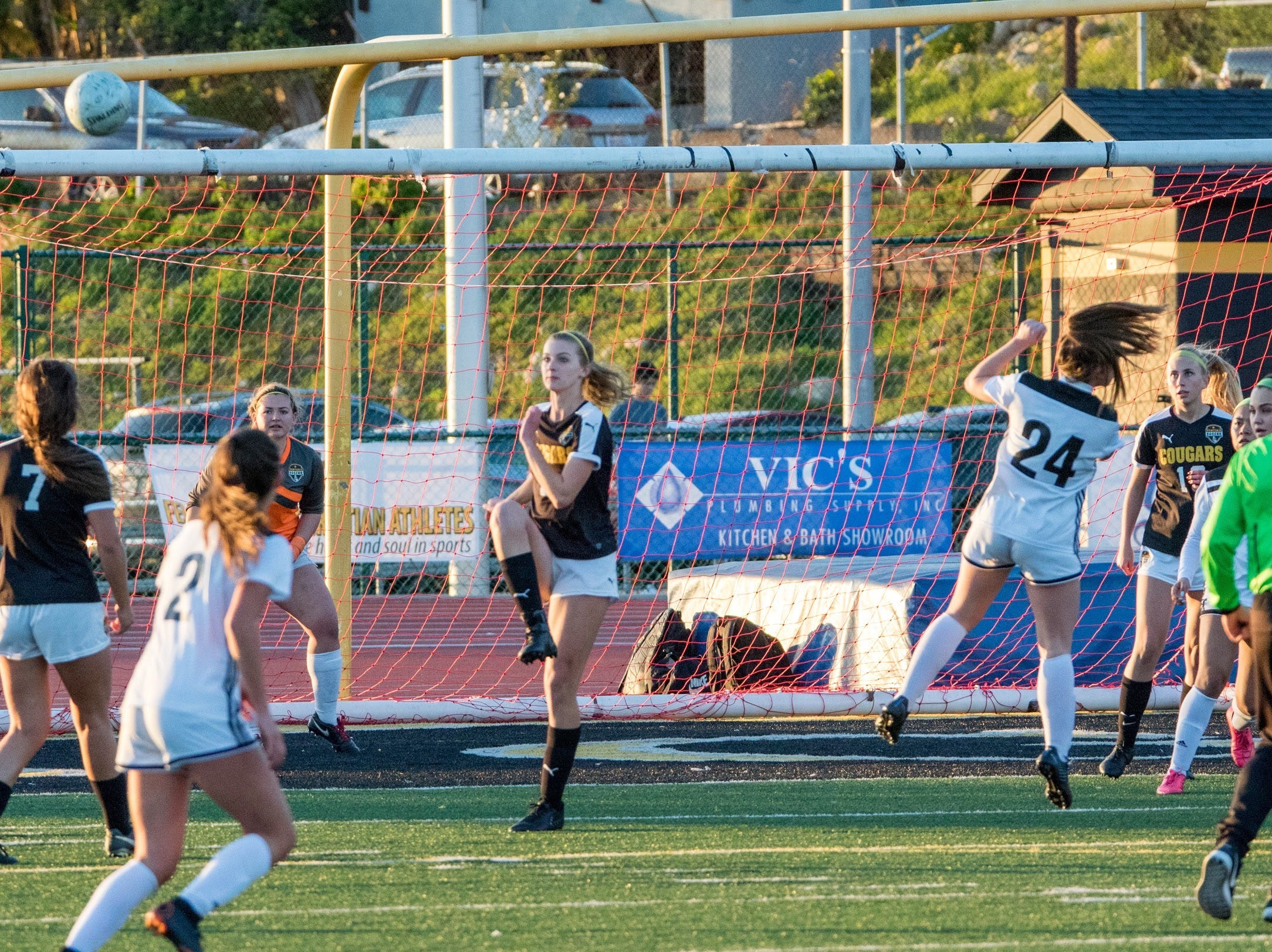 Ventura senior sweeper Alyssa Moore, center, clears the ball against Glendora on Friday in the second round of the CIF-Southern Section Division 2 girls soccer playoffs at Larrabee Stadium. Ventura won, 4-1.