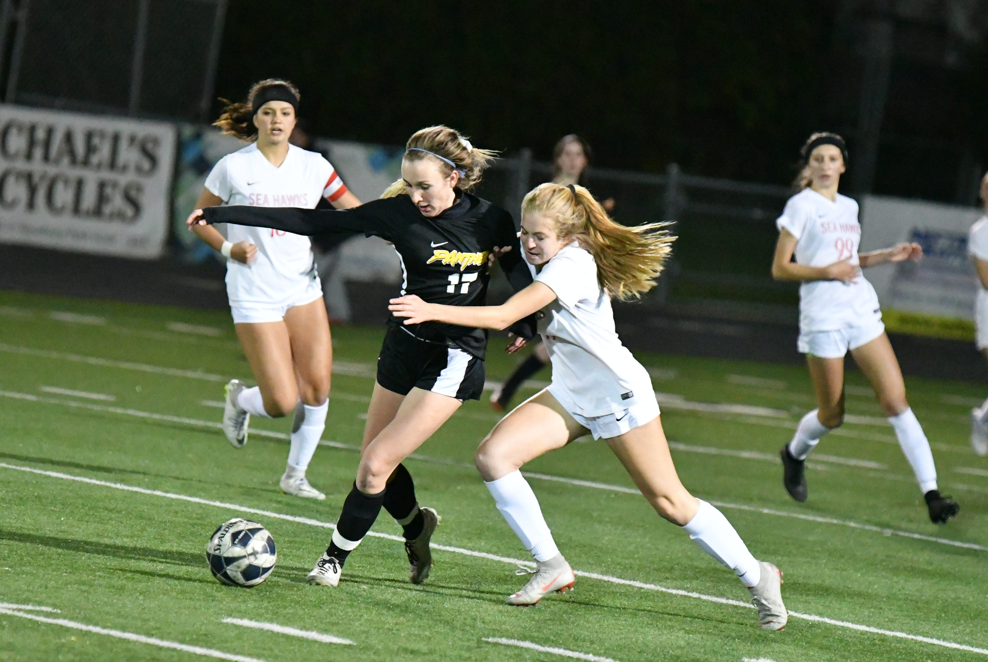 Newbury Park senior Kaitlyn McKeown, left, holds off a defender in Friday night's CIF-Southern Section Division 2 second-round match with Redondo Union.  Newbury Park edged Redondo Union 4-3 on PKs after a scoreless draw.