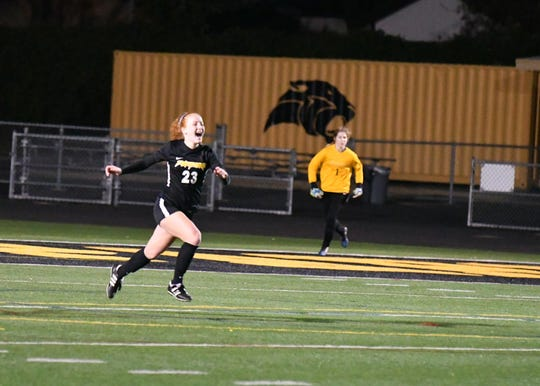 Senior Fiona Wyrick celebrates after converting the decisive penalty kick Friday night in the CIF-Southern Section Division 2 second round as Newbury Park edged visiting Redondo Union 4-3 on PKs after a scoreless draw.