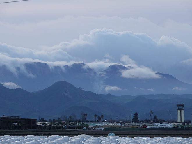 Clouds sinking over ridges in the Santa Monica Mountains behind the Camarillo Airport on a recent Saturday. A freeze warning is impacting parts of Ventura County overnight Monday, with the warning in effect between 3 a.m. to 8 a.m. Tuesday.