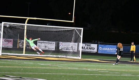Senior Fiona Wyrick converts the decisive penalty kick Friday night in the CIF-Southern Section Division 2 second round as Newbury Park edged visiting Redondo Union 4-3 on PKs after a scoreless draw.
