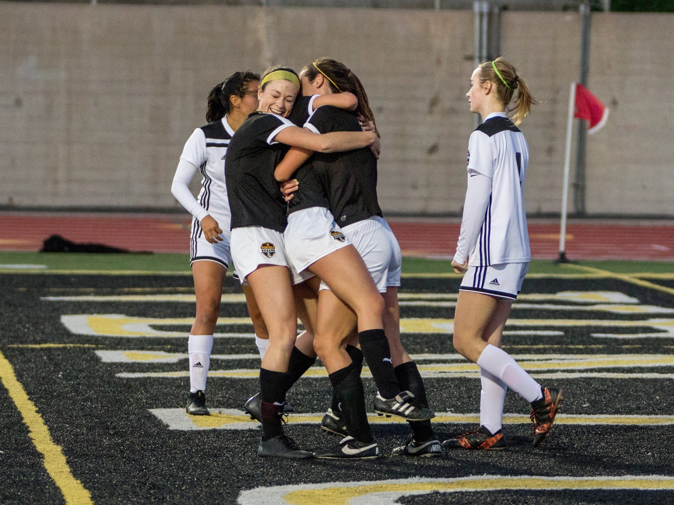 Cassidy Hubert, left, and Peyton Erickson embrace Alex Kwasny after the senior midfielder scored to tie the game in the first half of Ventura High's win over visiting Glendora on Friday night in the second round of the CIF-Southern Section Division 2 girls soccer playoffs at Larrabee Stadium. Ventura won, 4-1.