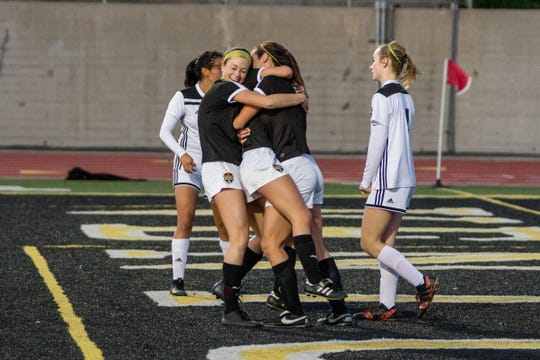 Cassidy Hubert and Peyton Erickson, shown embracing teammate Alex Kwasny after a goal last month against Glendora, combined to score 42 goals for the Ventura High girls soccer team this season.