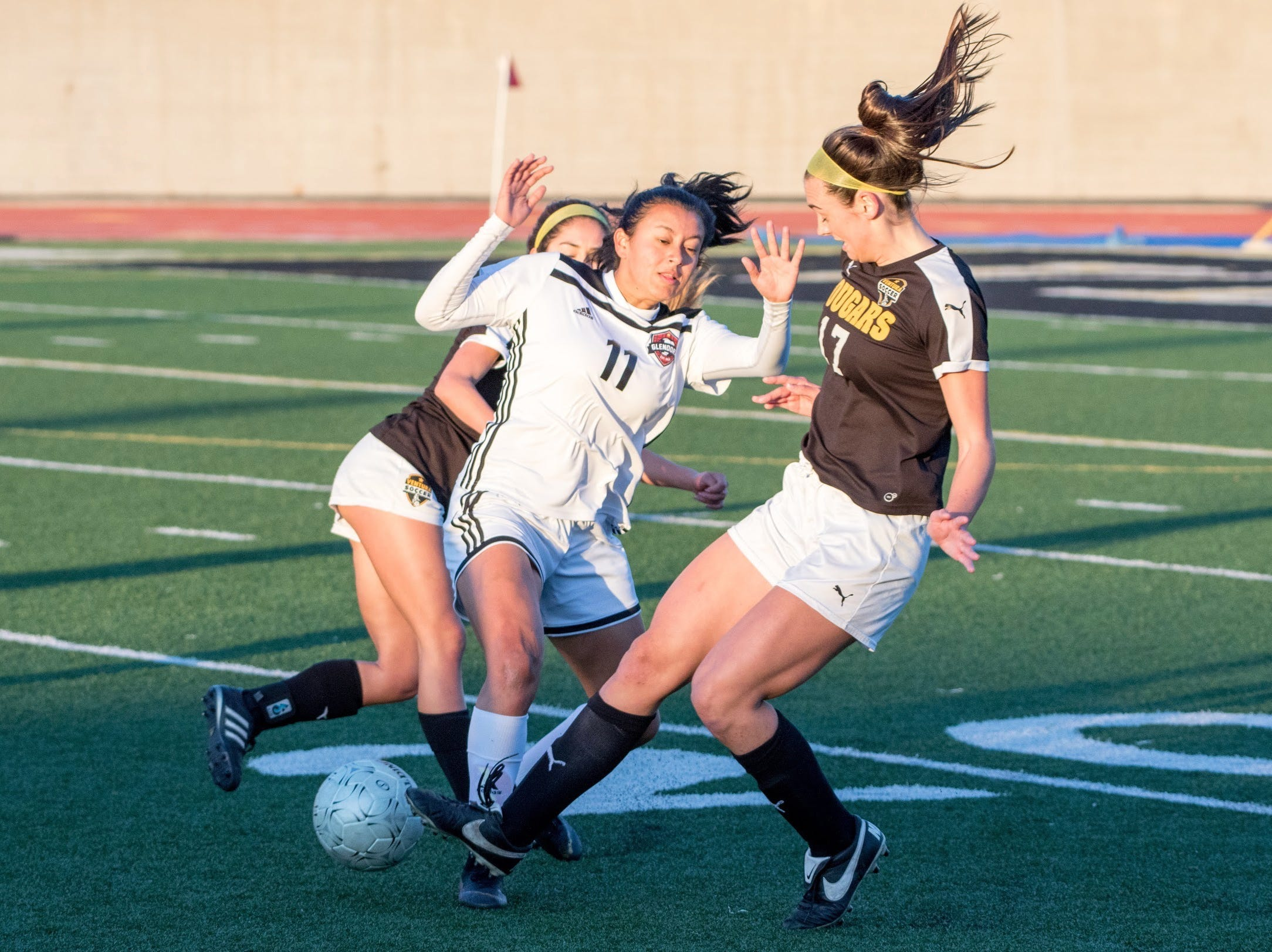 Ventura senior Peyton Erickson, right, battles with Glendora's Sierra Reich on Friday in the second round of the CIF-Southern Section Division 2 girls soccer playoffs at Larrabee Stadium. Ventura won, 4-1.