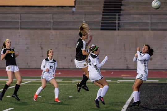 Senior Alex Kwasny rises to head home the tying goal for in the first half of Ventura's 4-1 win over visiting Glendora in the second round of the CIF-Southern Section Division 2 girls soccer playoffs at Larrabee Stadium on Friday night.