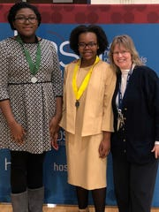 Destiny Simmons (left) and Jessica Michel, CCTEC students who competed successfully in the Researched Persuasive Writing and Speaking category during a HOSA competition held Feb. 2, are joined by HOSA Advisor Char Birdsall.