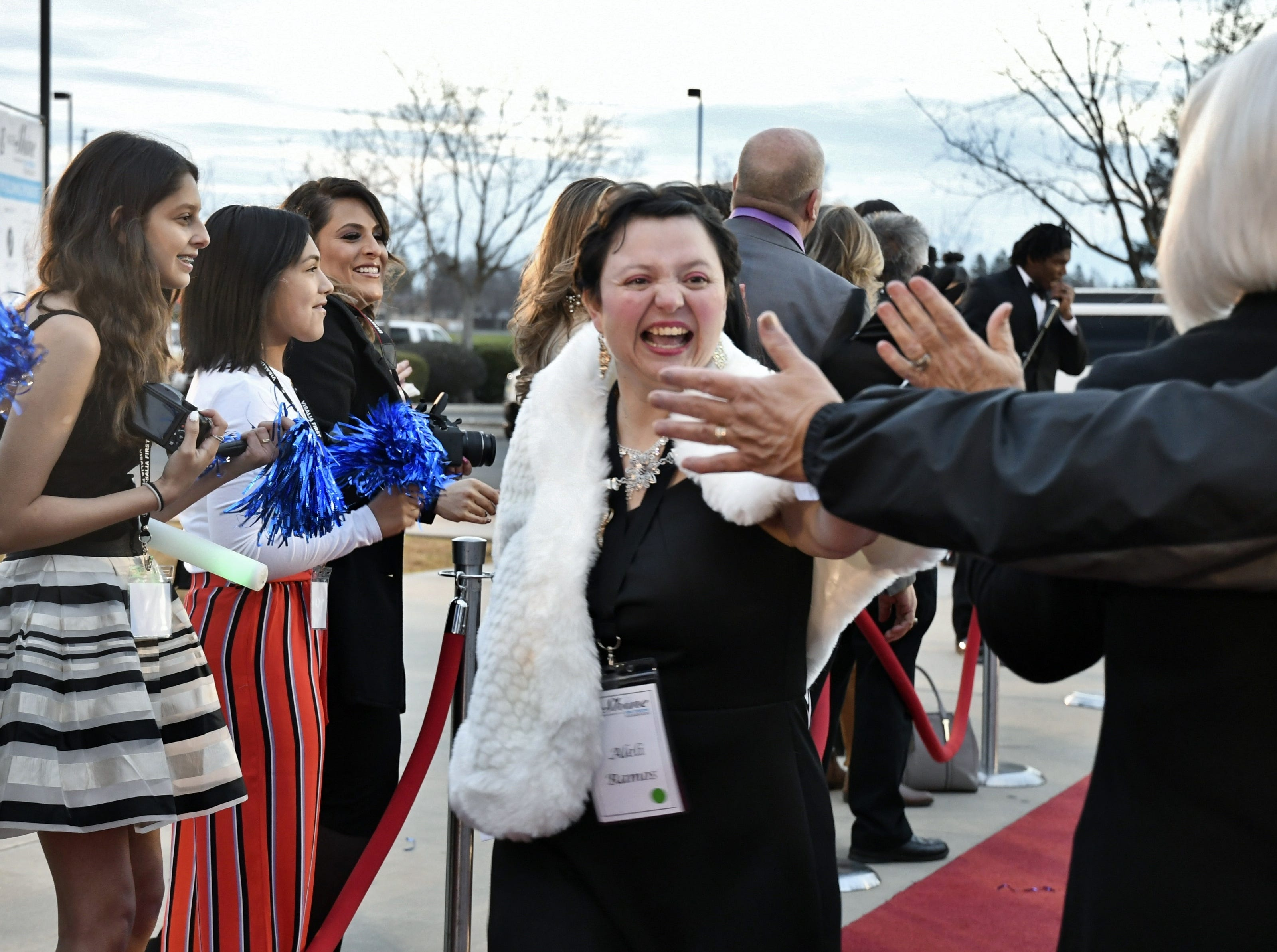 Guests and volunteers dazzle at the Night to Shine Prom event at Visalia First Assembly on Friday, February 8, 2019. The dance, sponsored by the Tim Tebow Foundation, was open to Tulare County residents with special needs and their families. Guests arrived in style in a limousine and walked down a red carpet to the dance. The night included dinner, hair and makeup stations, prom favors, karaoke, dancing and the crowing of each guest as prom king or queen.