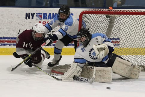 Scarsdale's Jack Brosgol tries to get a shot past Suffern's Gunnar Marks and goalie Mike Halper during their game at Sport-O-Rama Feb. 8, 2019. Suffern won 7-3.