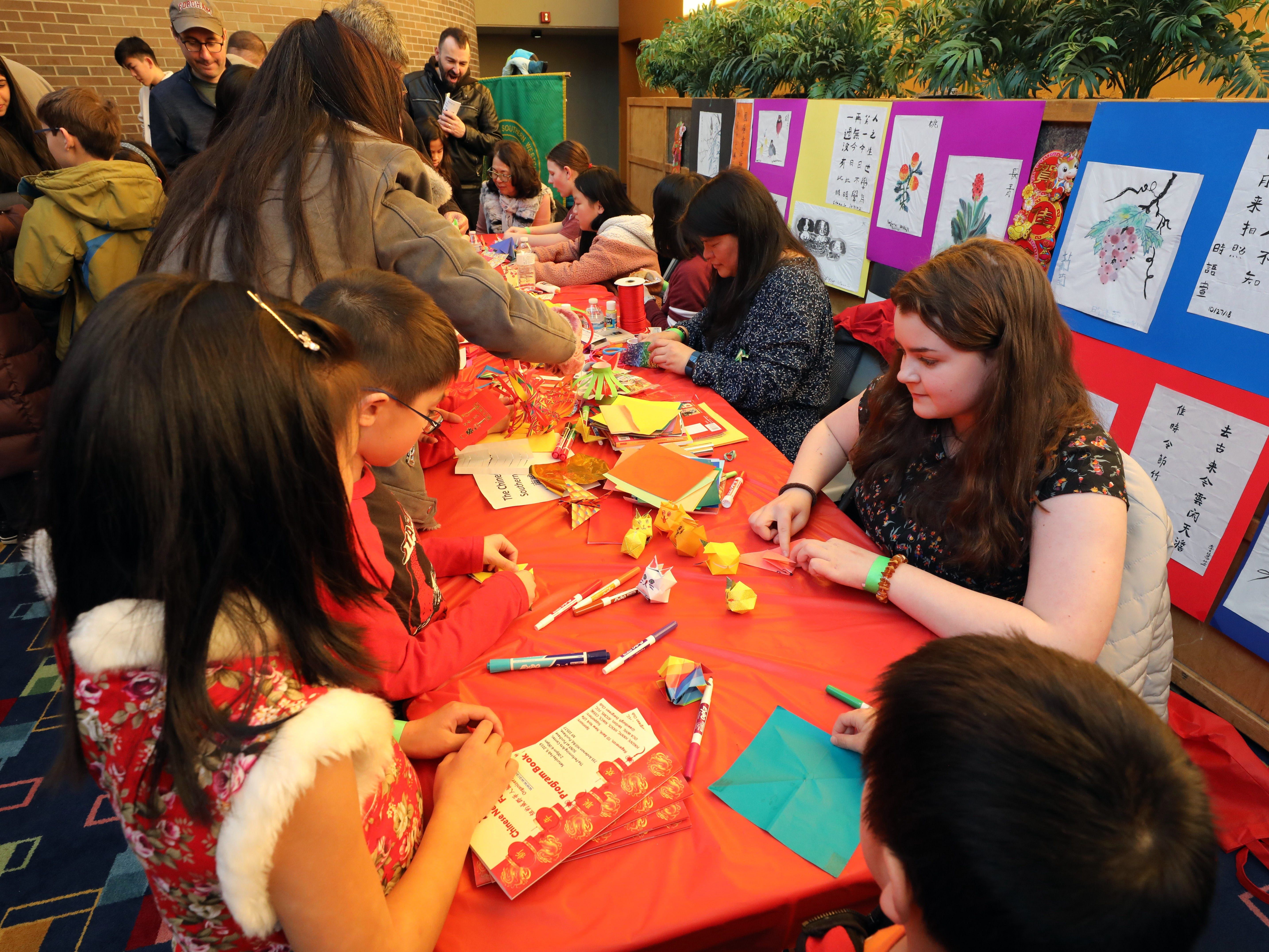 Children work on crafts during the 30th Chinese New Year Festival, the Year of the Pig, sponsored by WACA (Westchester Association of Chinese Americans), at The Performing Arts Center at Purchase College SUNY, Feb. 9, 2019.
