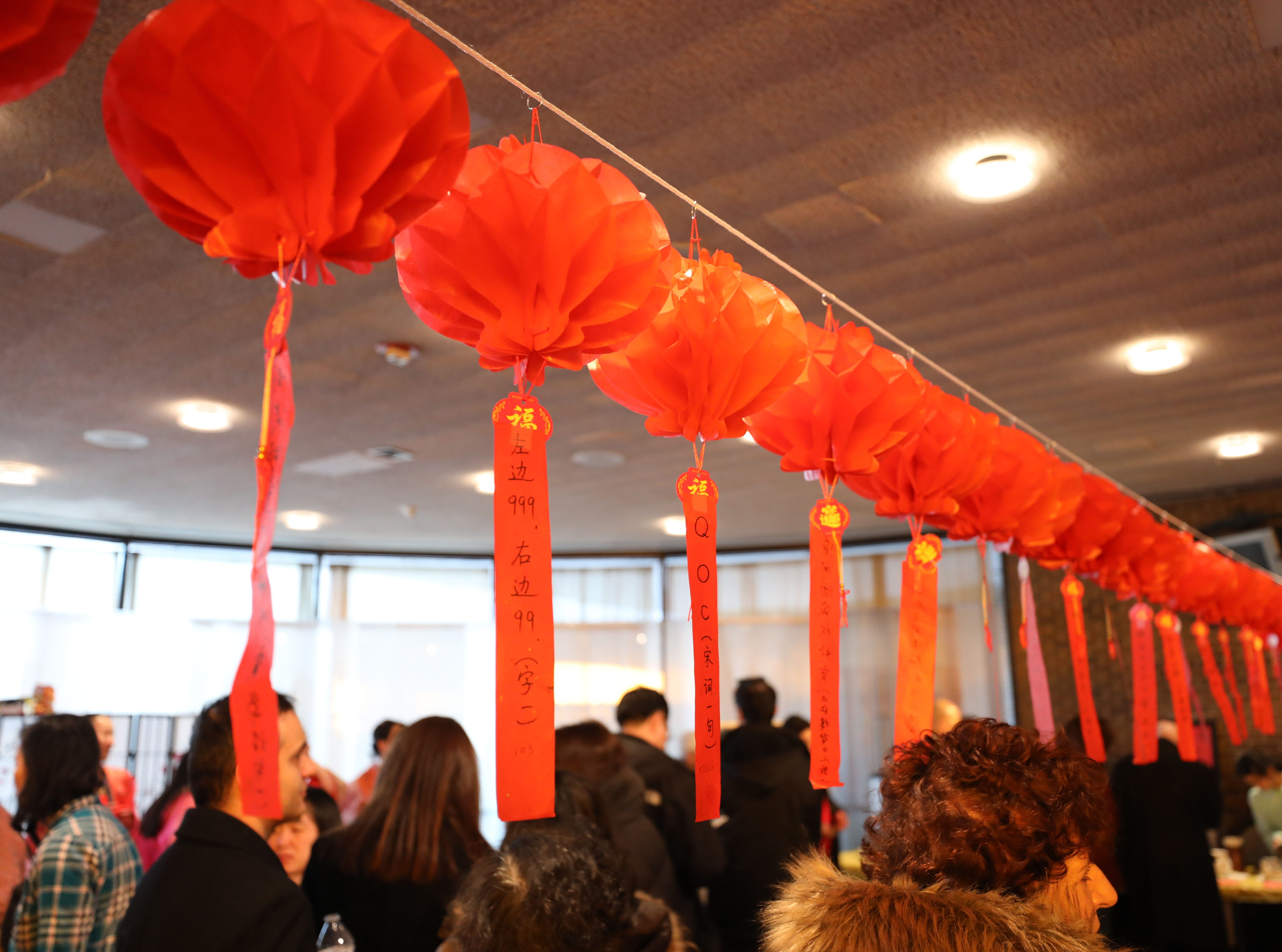 Lanterns with Chinese puzzles, hang from a cord during the 30th Chinese New Year Festival, the Year of the Pig, sponsored by WACA (Westchester Association of Chinese Americans), at The Performing Arts Center at Purchase College SUNY, Feb. 9, 2019.