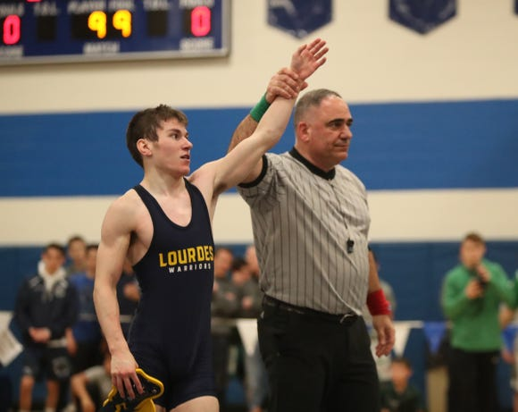 Our Lady of Lourdes' Chris Dimeglio defeats Edgemont's Jack Novarro in the 113-pound match of the division II wrestling finals at Edgemont High School on Saturday, February 9, 2019.