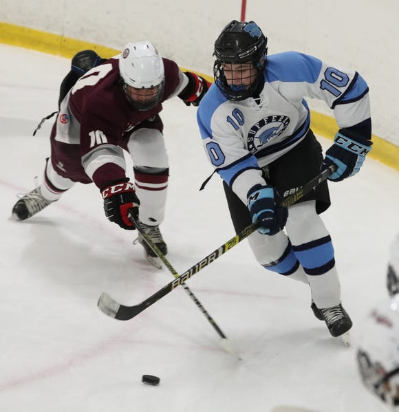 Suffern's Tommy McCarren skates past Scarsdale's Josh Bank during their game at Sport-O-Rama Feb. 8, 2019. Suffern won 7-3.