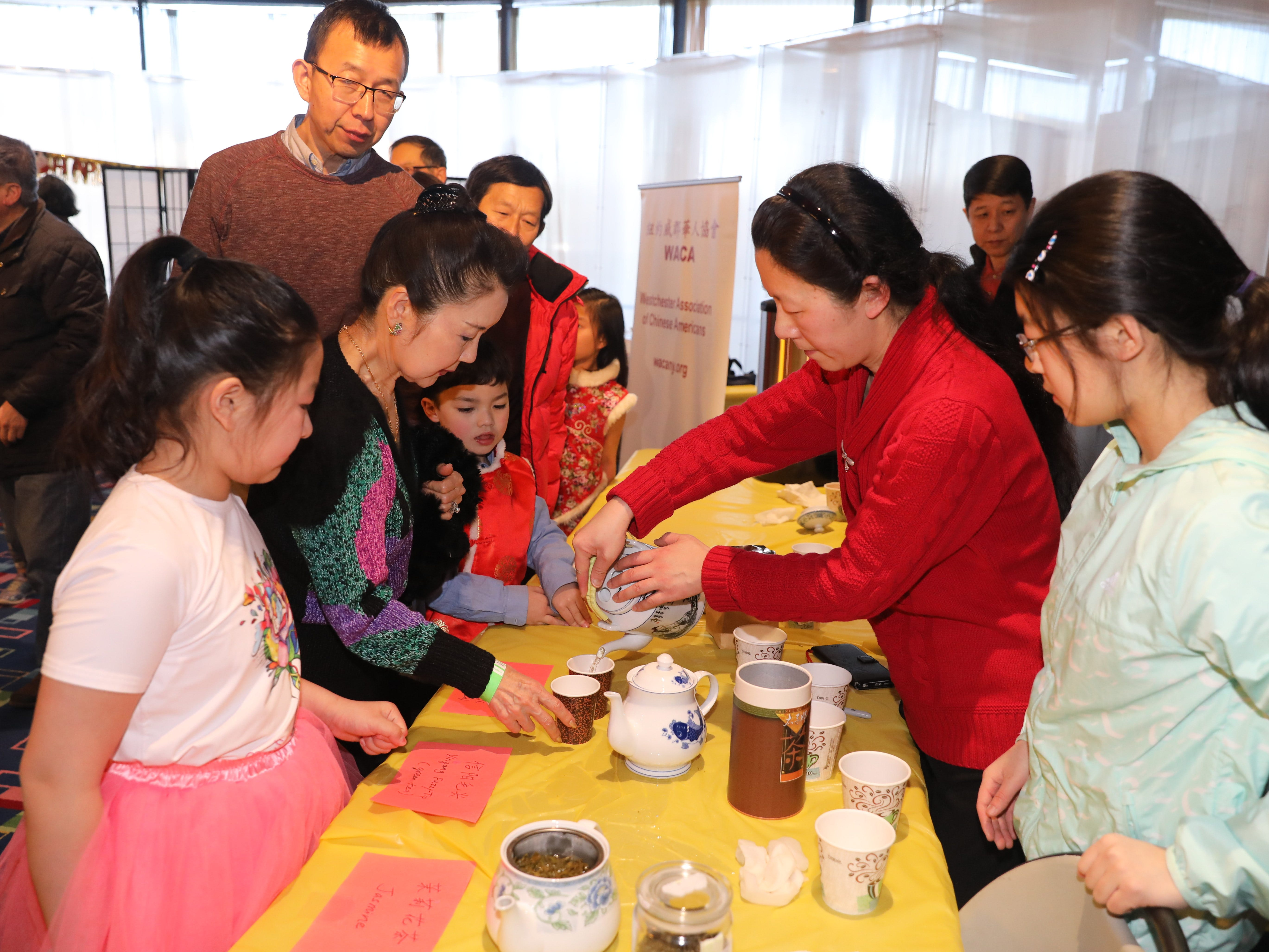 Zoe Xiong, pours authentic Chinese teas, during the 30th Chinese New Year Festival, the Year of the Pig, sponsored by WACA (Westchester Association of Chinese Americans), at The Performing Arts Center at Purchase College SUNY, Feb. 9, 2019.