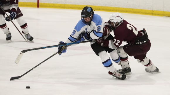 Suffern's Jared Marder is pressured by Scarsdale's Joshua Abbott during their game at Sport-O-Rama Feb. 8, 2019. Suffern won 7-3.